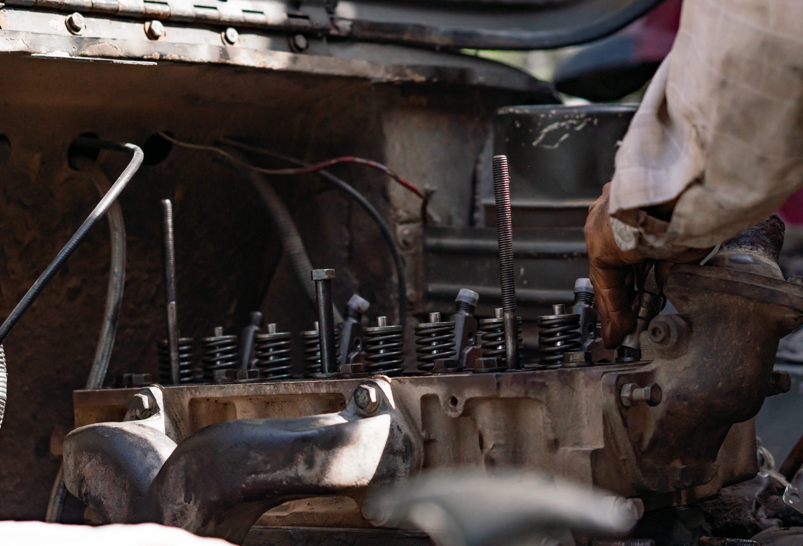 A man Repairing and Fixing Car Engine