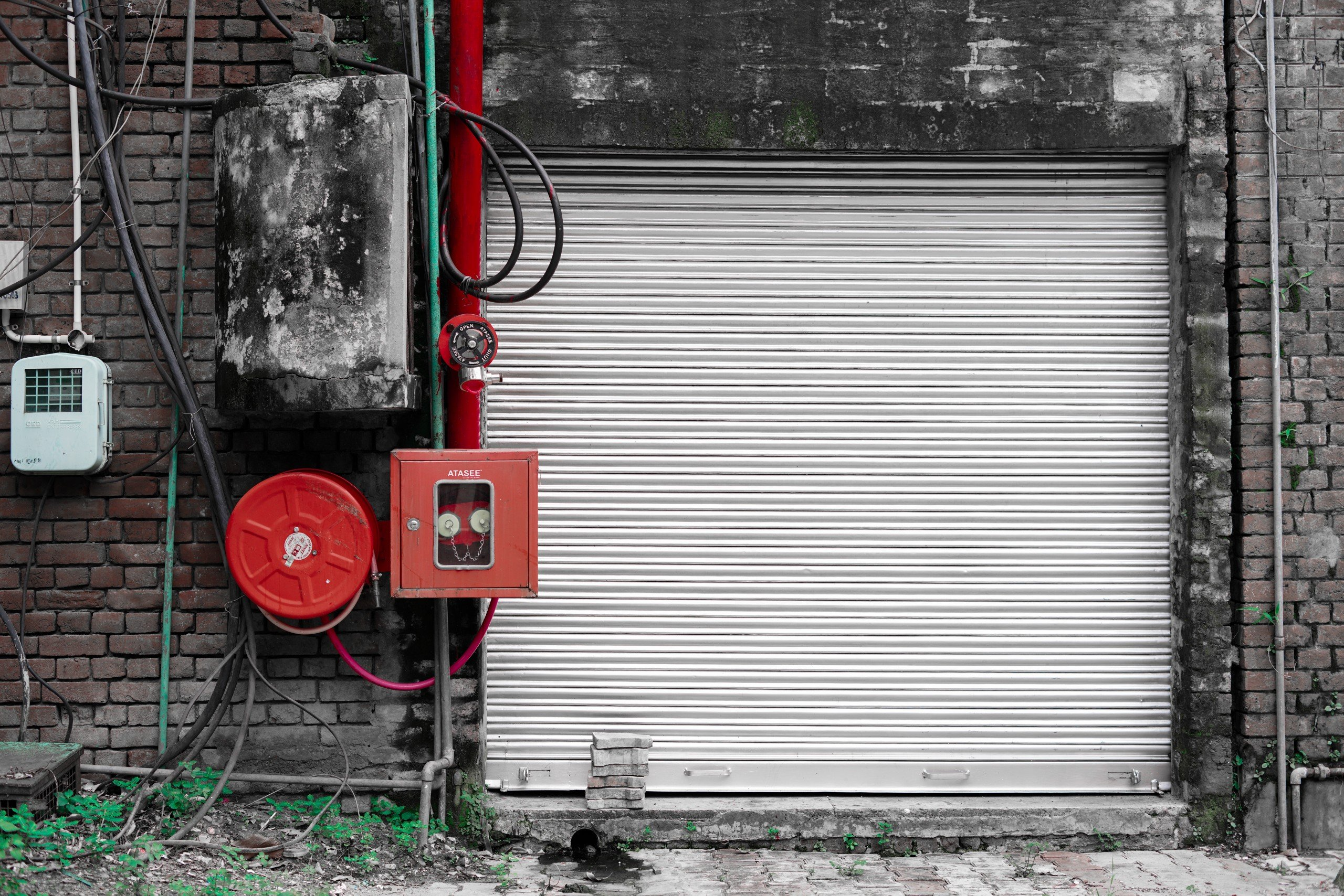 A Shuttered Shop With Fire Box