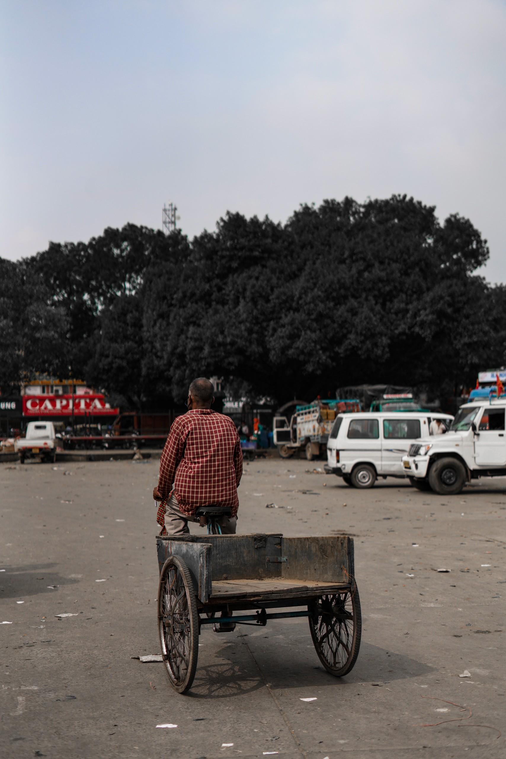 man riding a cart cycle
