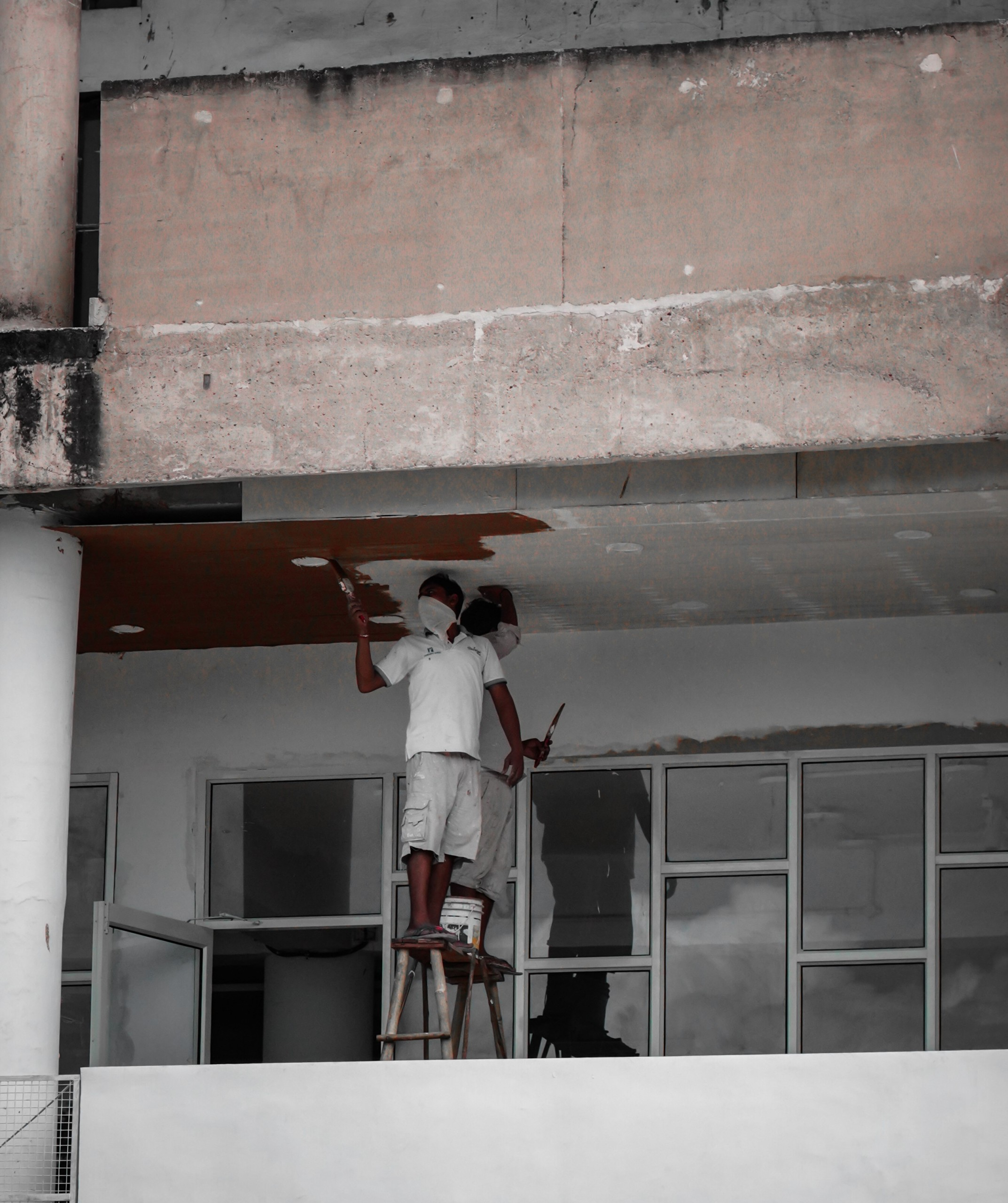 Painters painting a ceiling