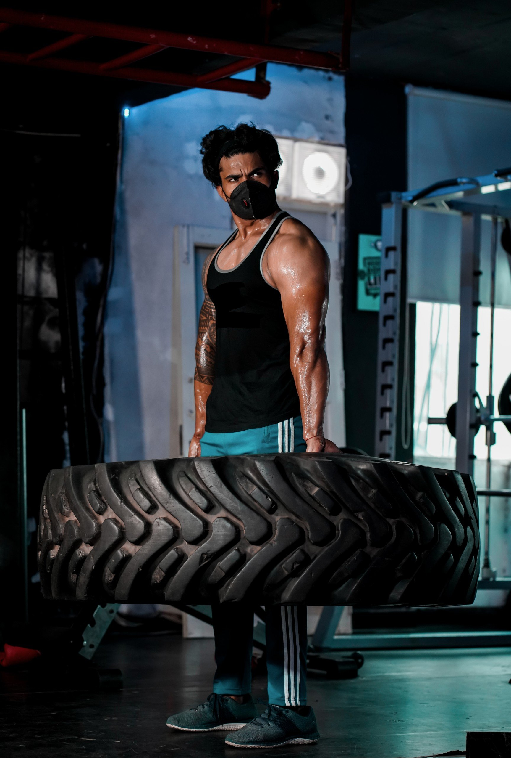A gym goer lifting truck Tyre