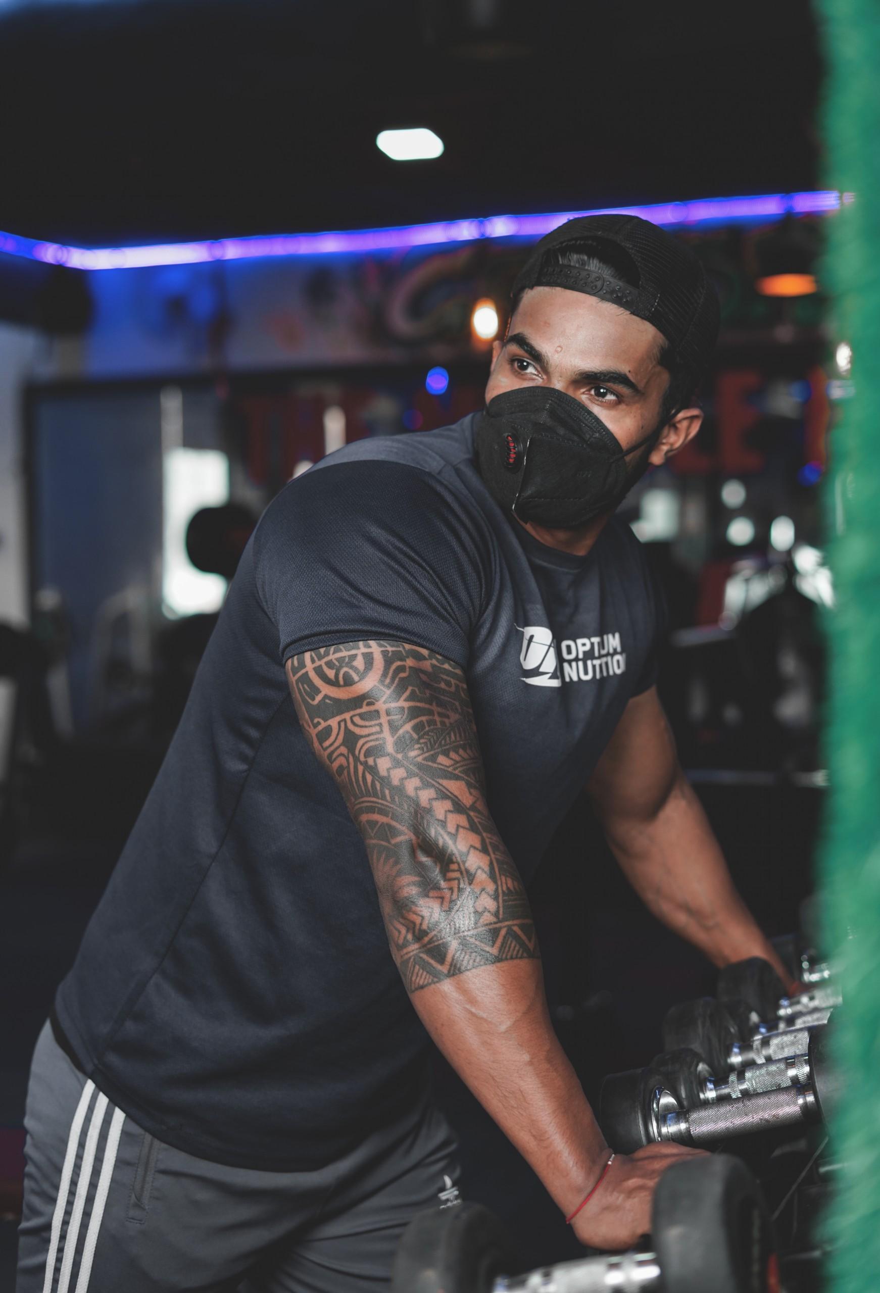 A masked man in gym