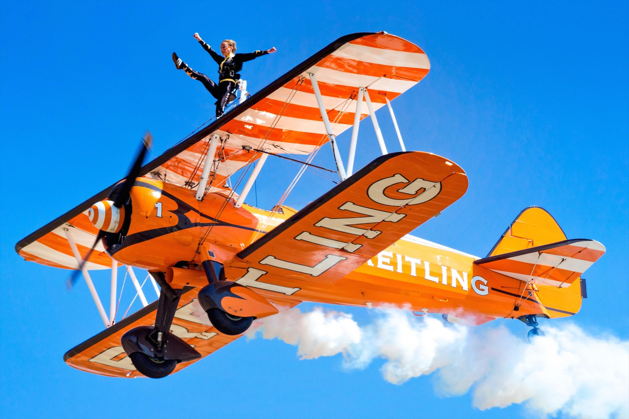 A wing walker on a biplane