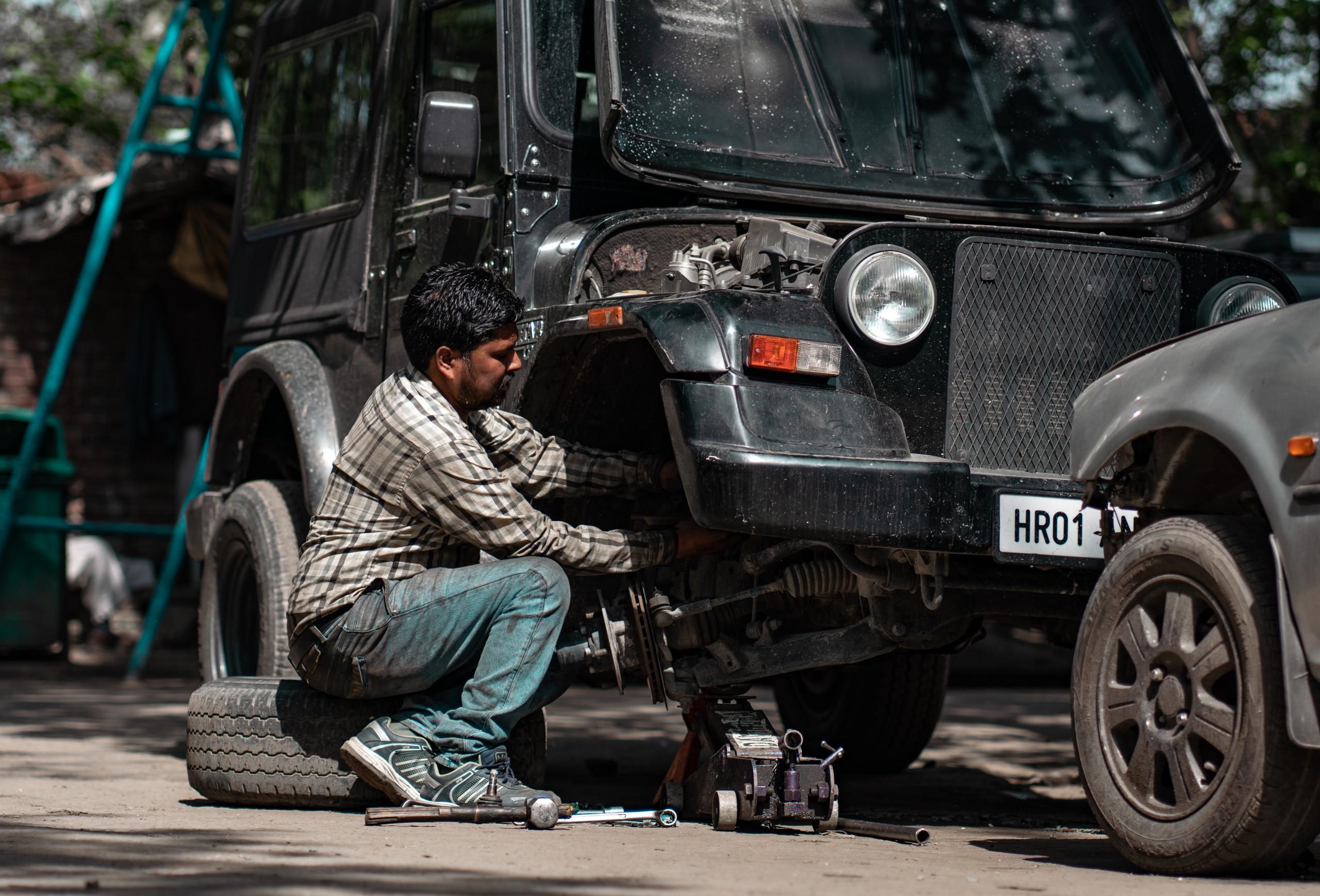 Automobile Mechanic fixing Tire