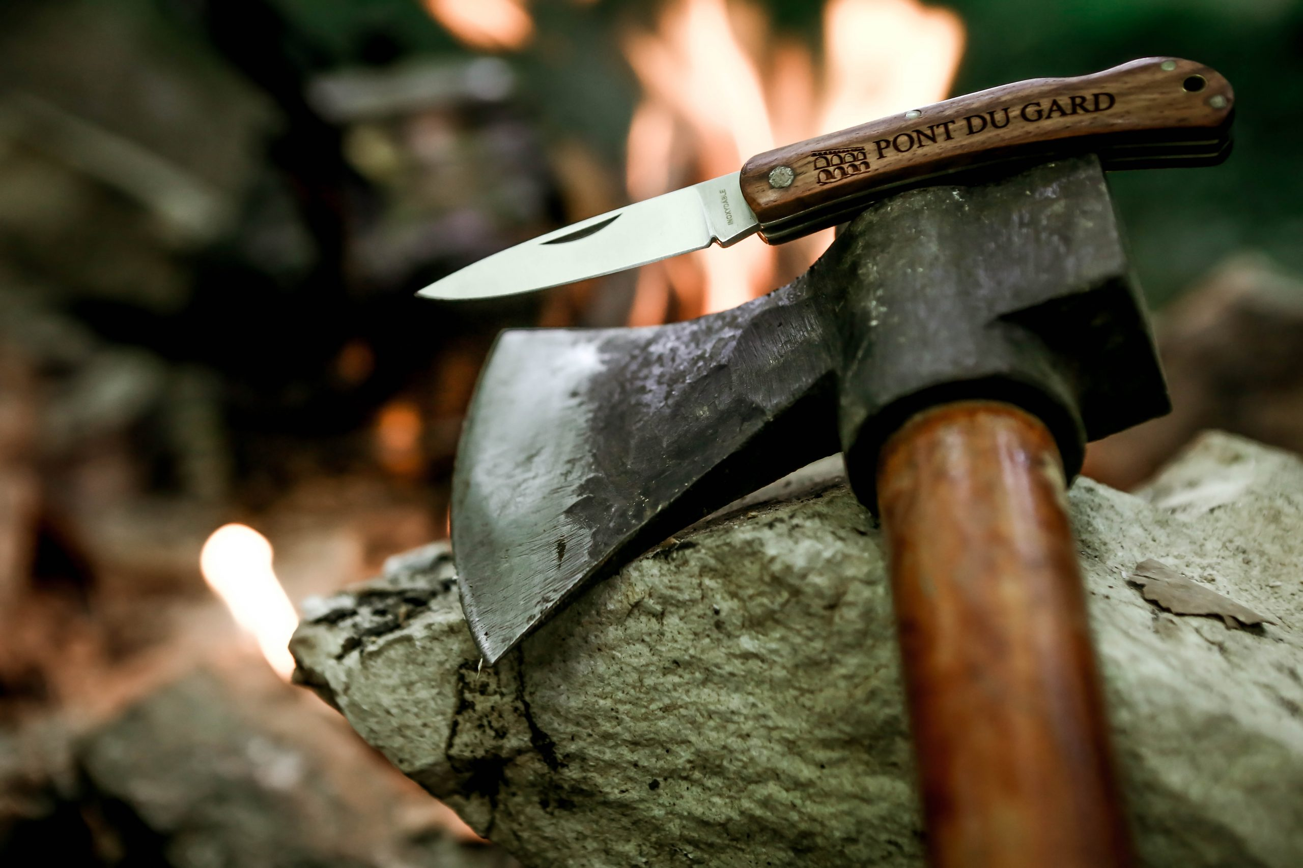 Ax and pocket knife on a Rock