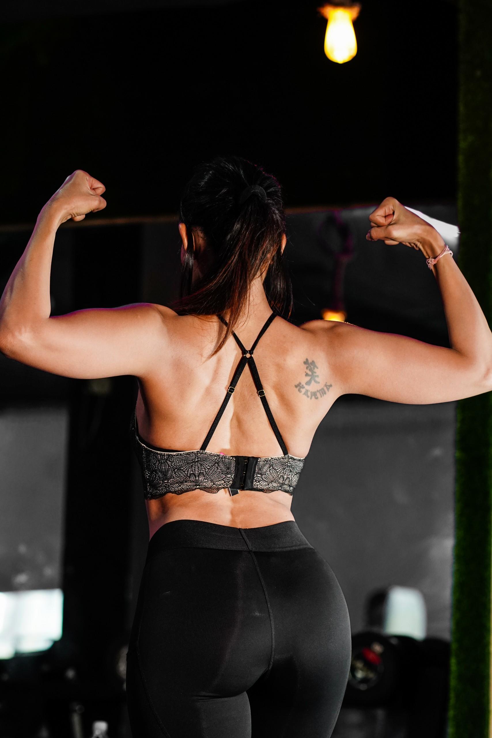 Fit Woman Flexing Muscle