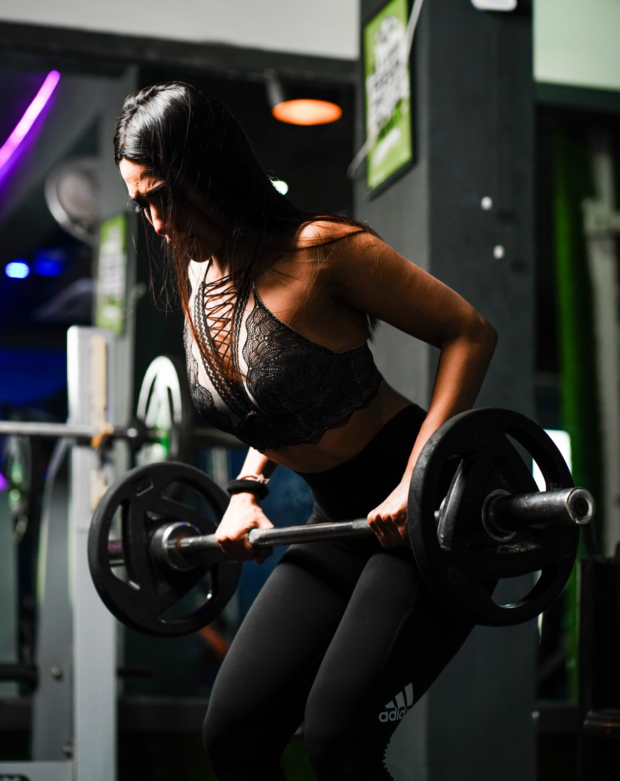 A Woman doing a weight lifting