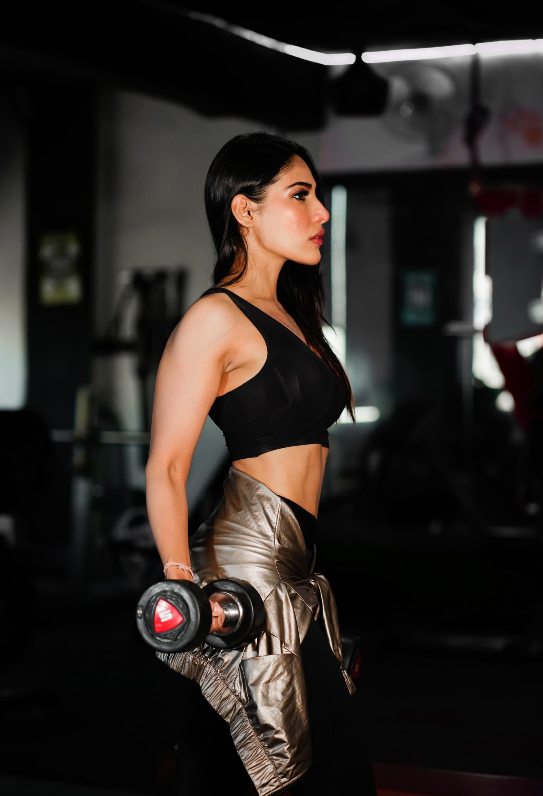 Beautiful female model in gym