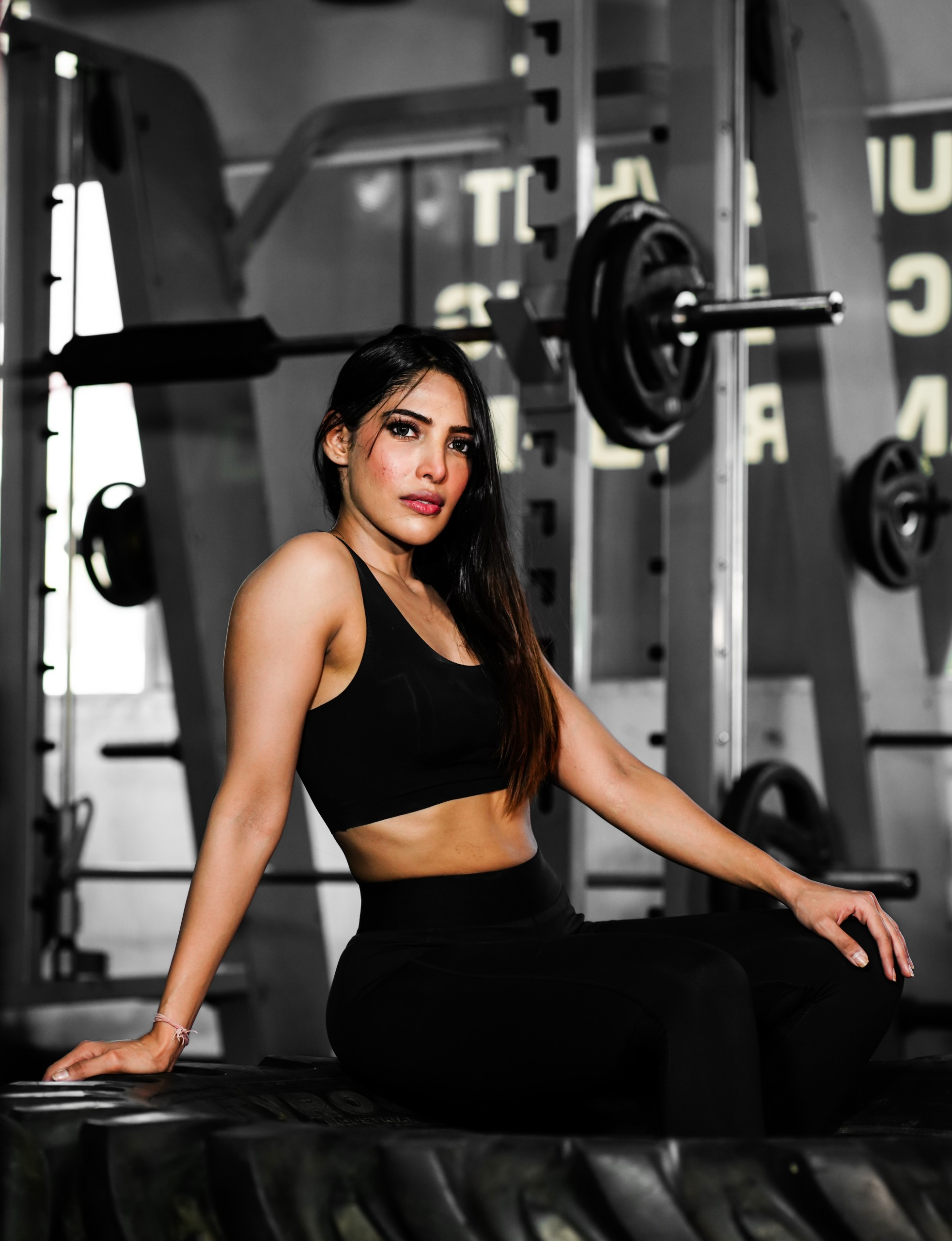 Beautiful woman pose after workout in gym