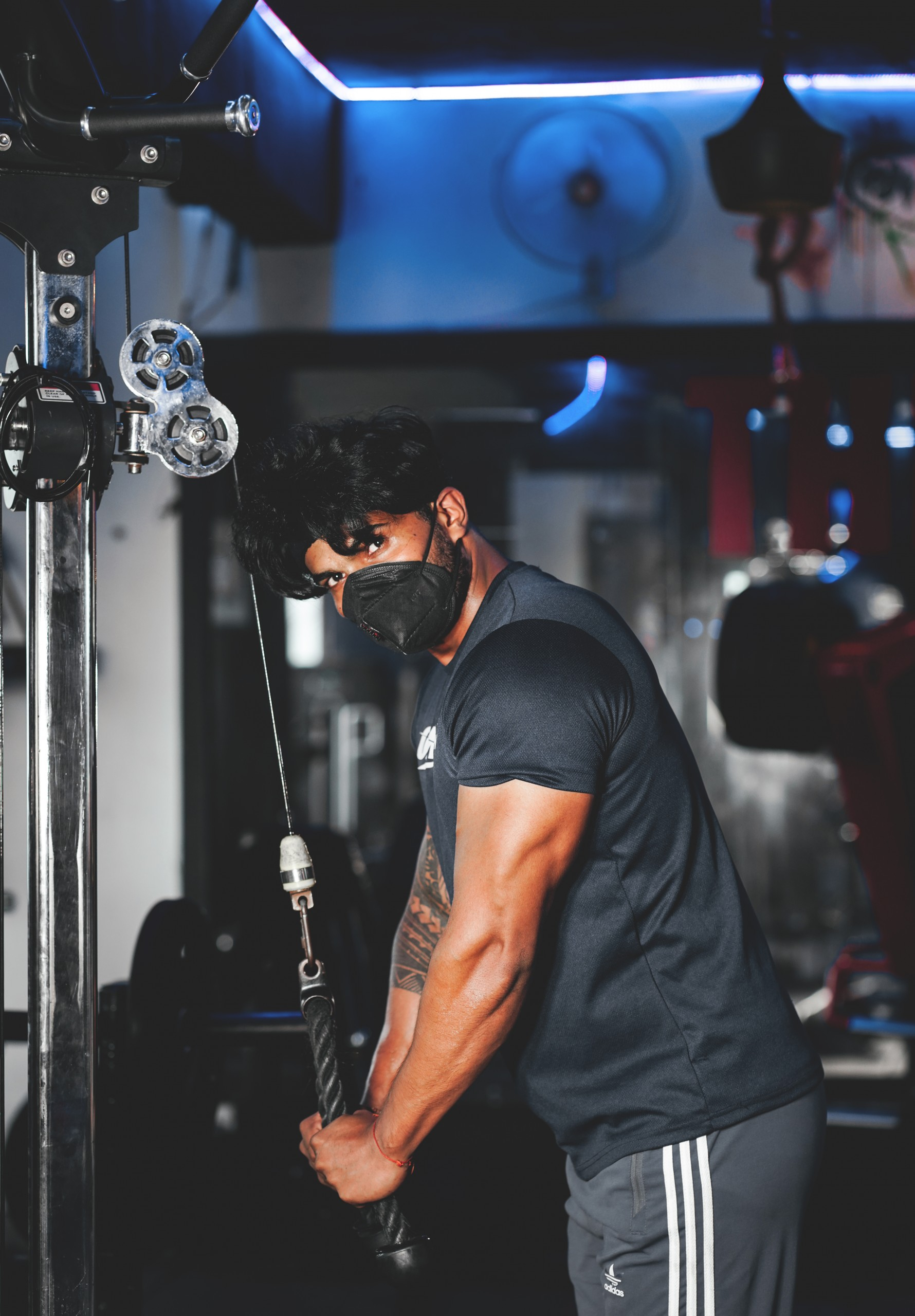 Bodybuilder Workout Triceps Push-down in the Gym