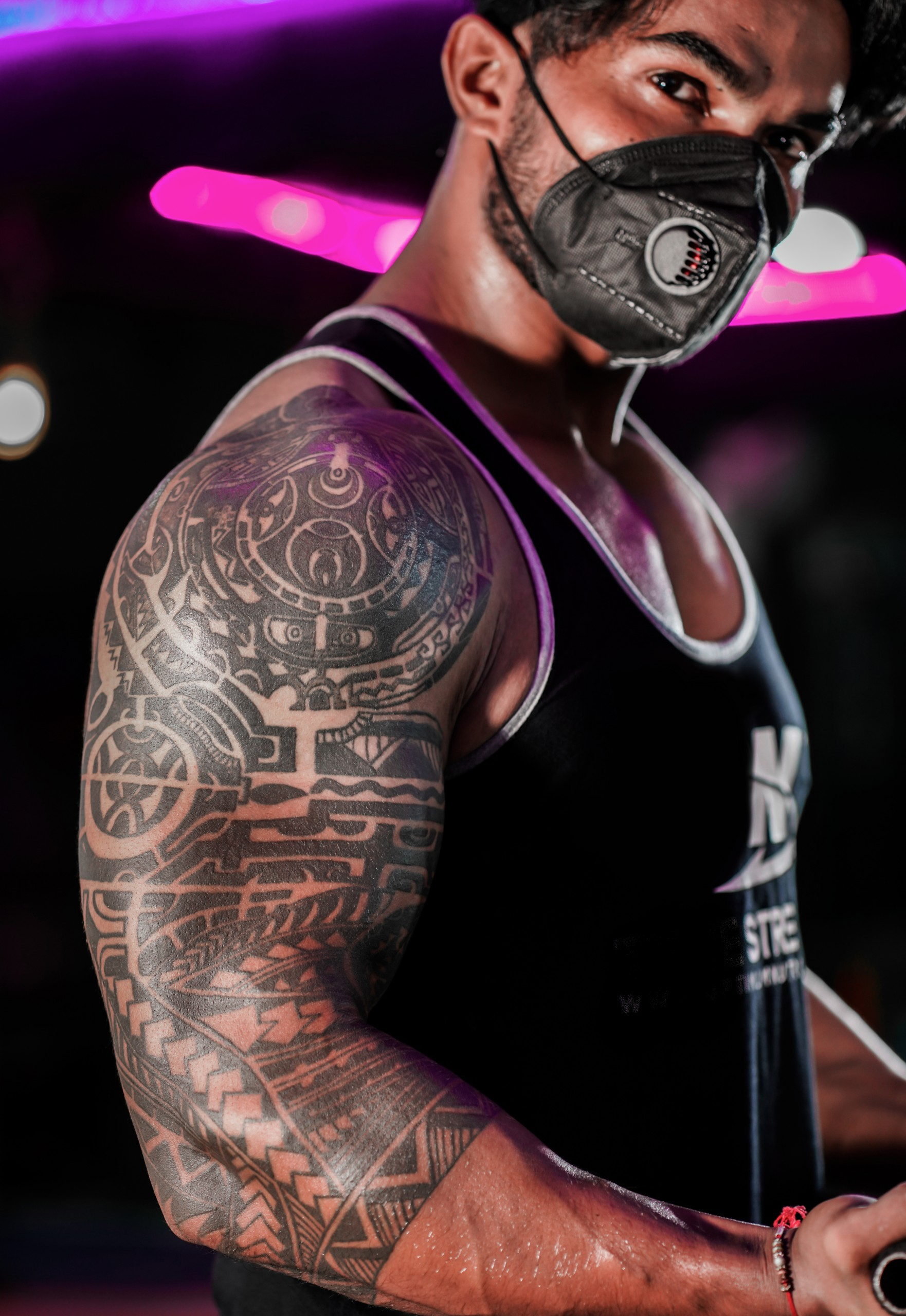 Bodybuilder biceps tattoo
