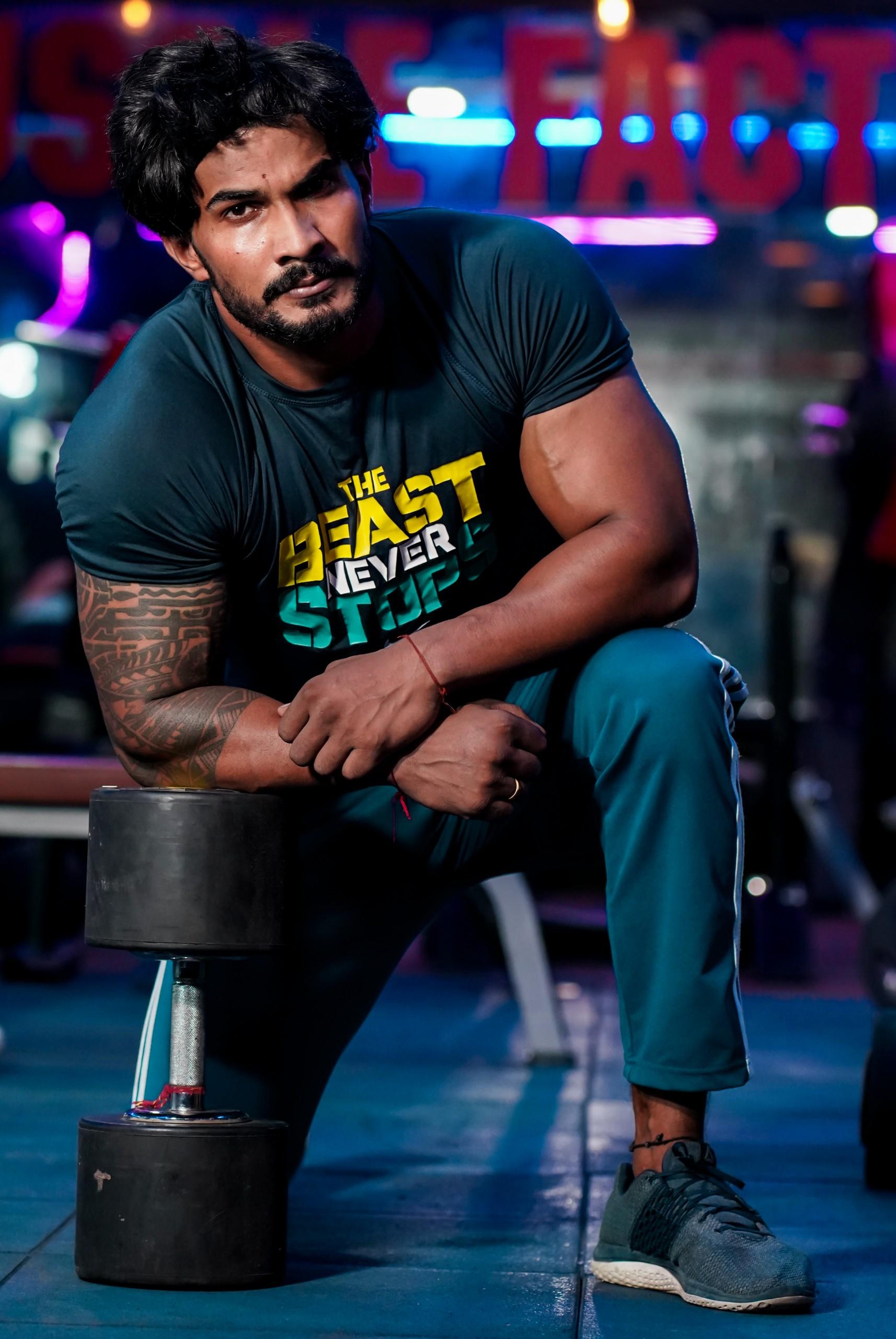 Bodybuilder posing with dumbbell