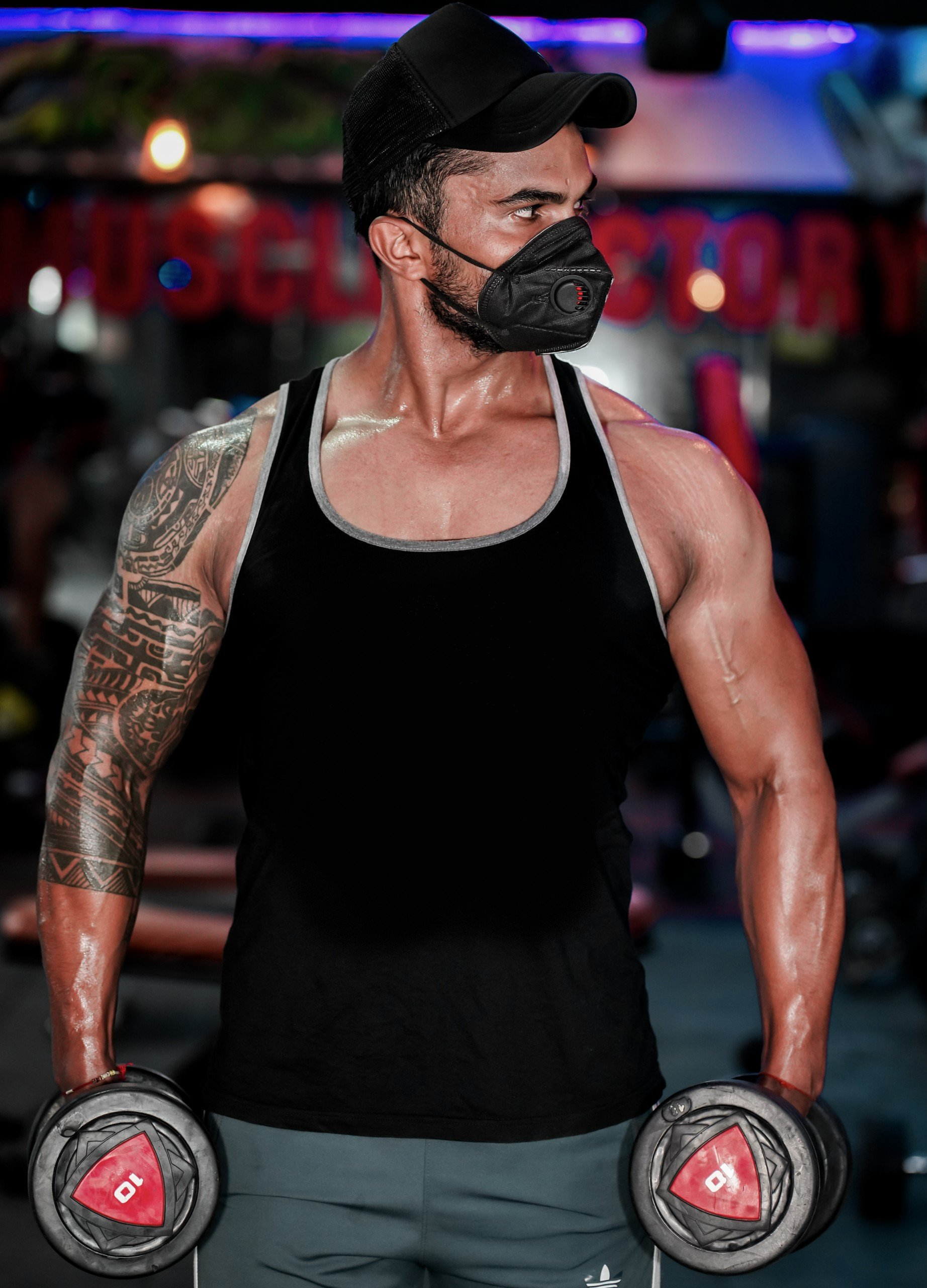 Bodybuilder wearing mask in gym