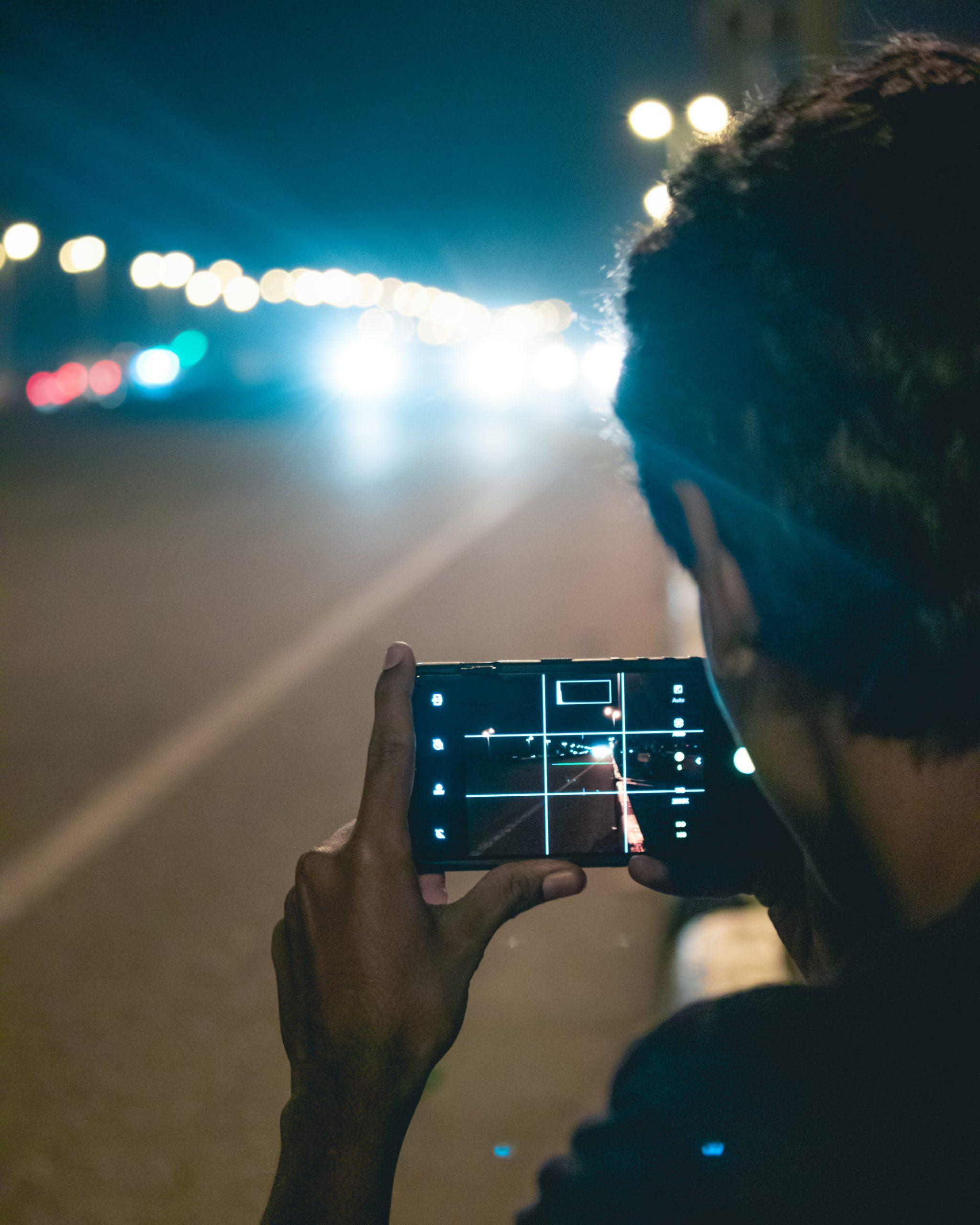Boy taking photo of vehicles