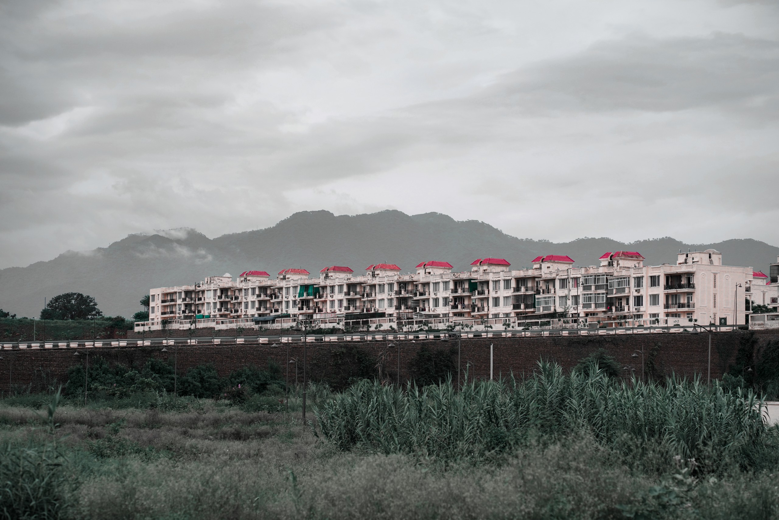 Buildings against tall mountains