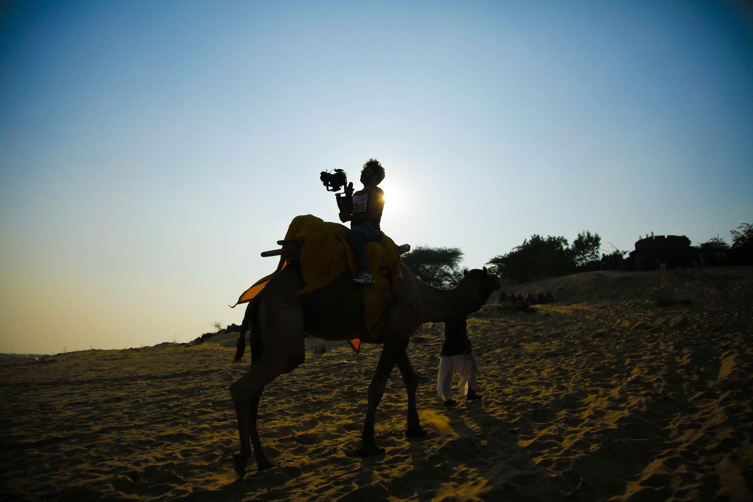 Cameraman on camel silhouette