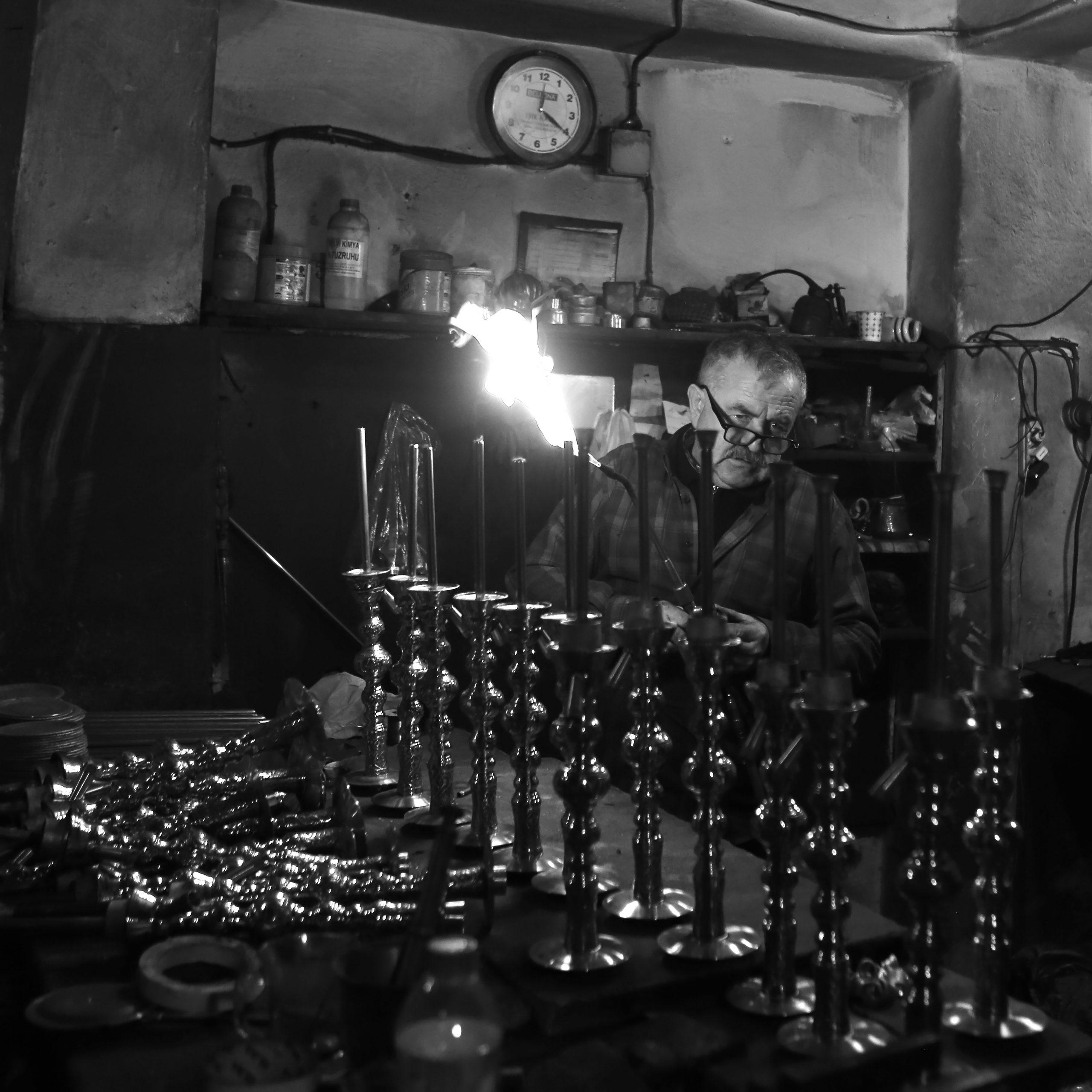Candlestick producing man
