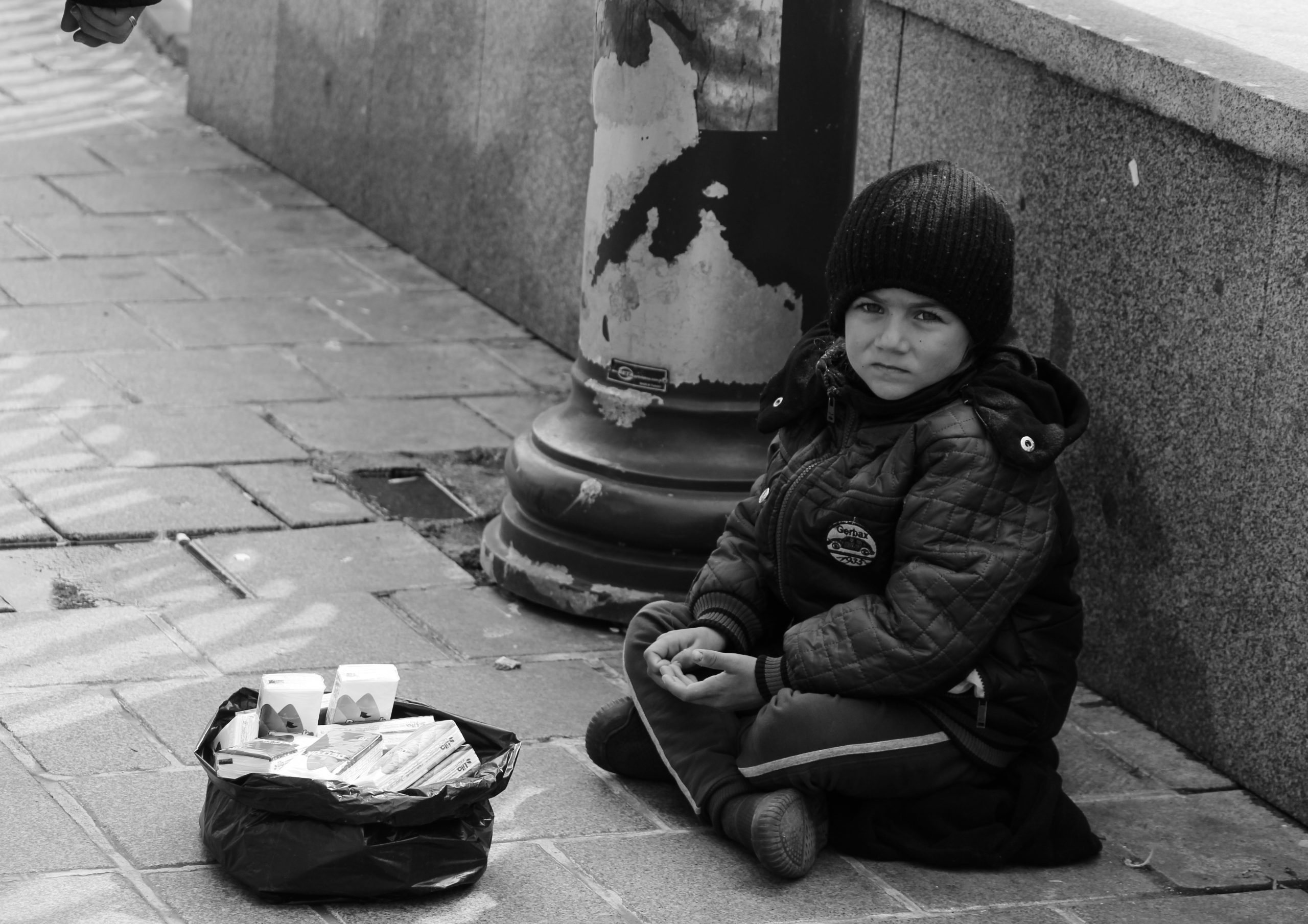 Child selling handkerchief on the street
