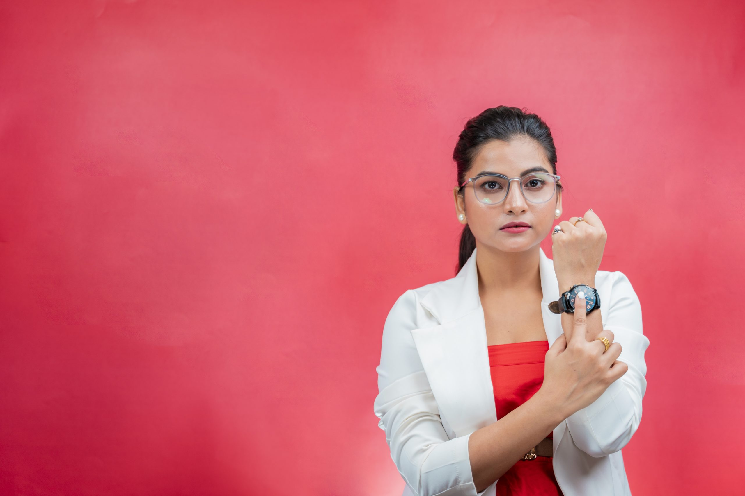 Confident woman showing wrist watch