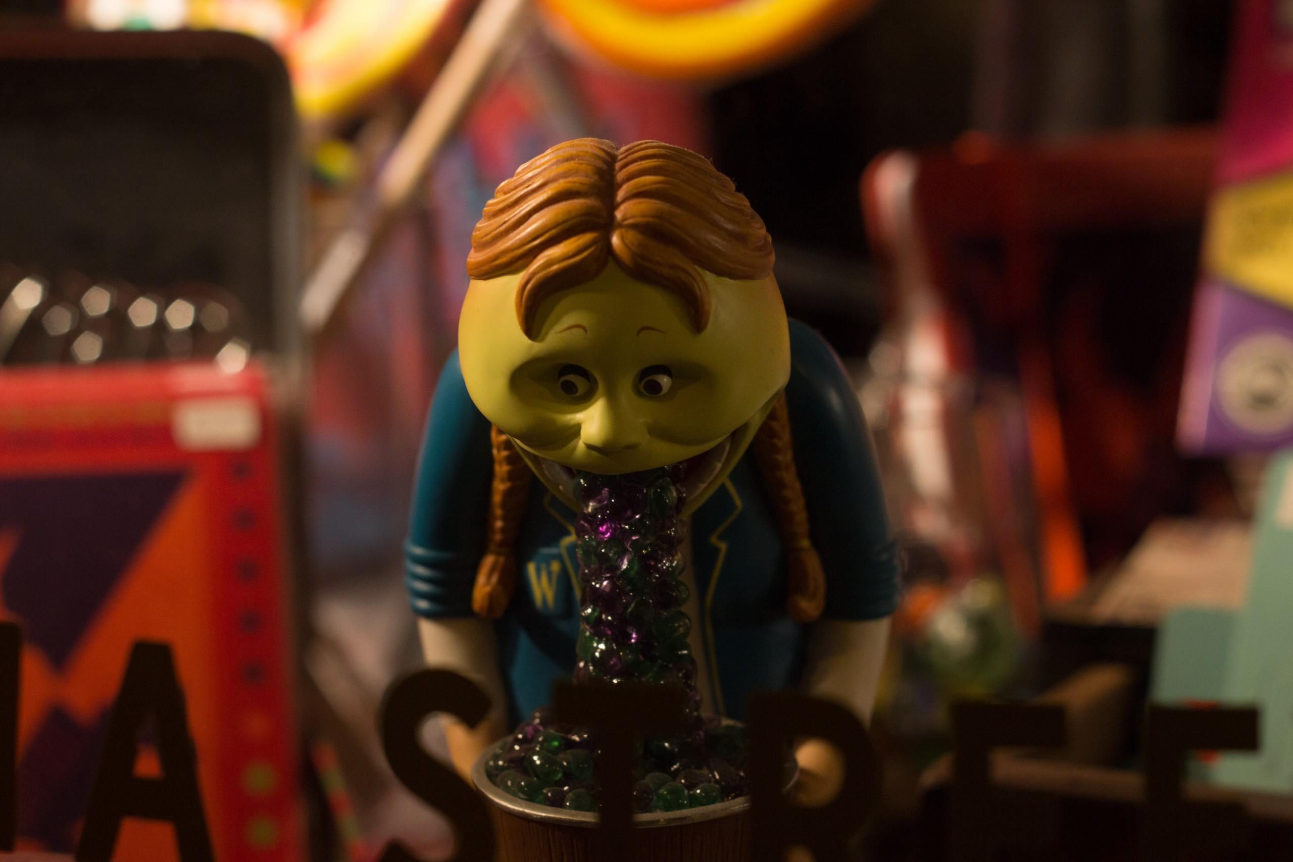 Toy vomiting gems