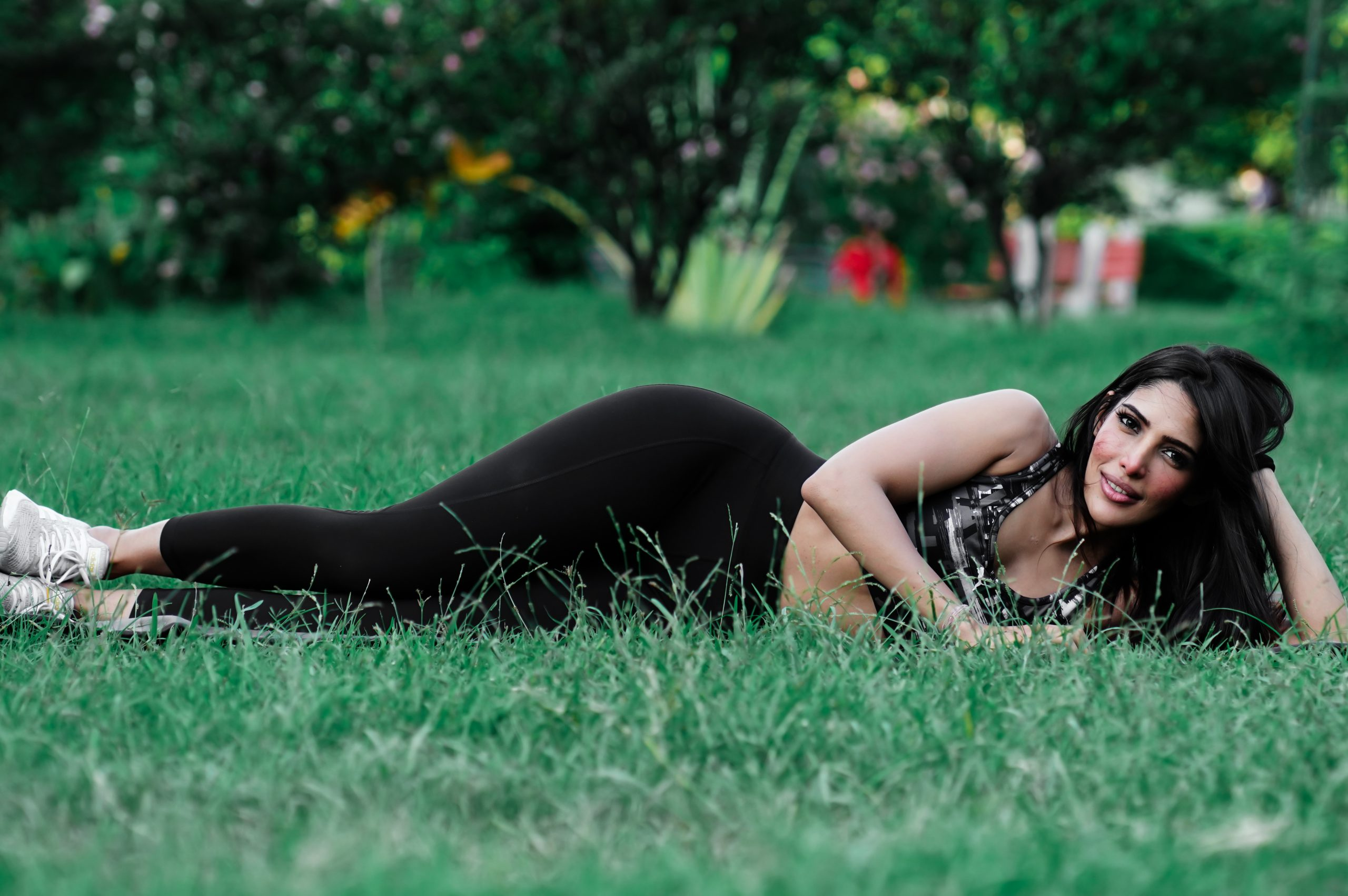 Female lying after yoga in park