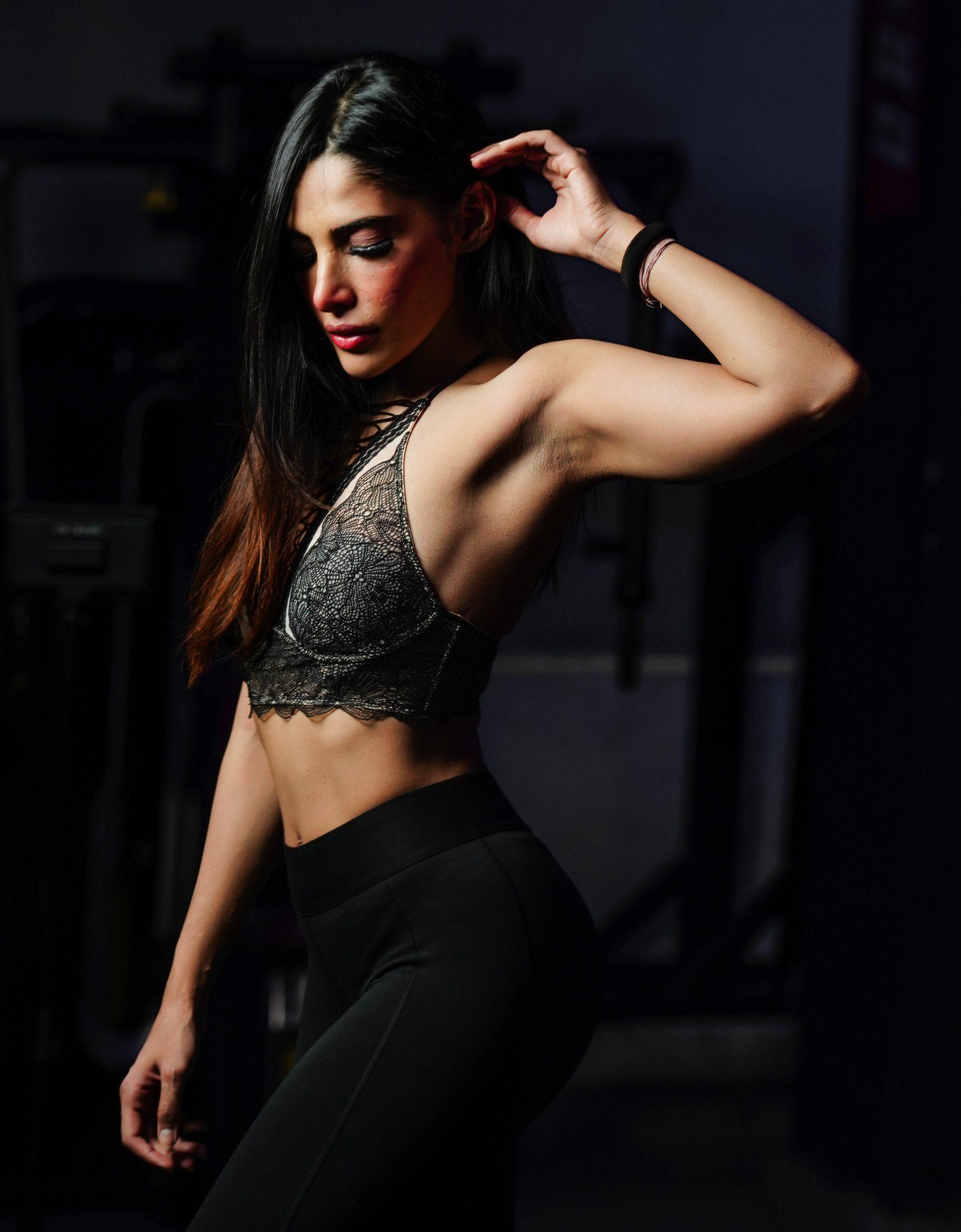 Female pose in black dark background