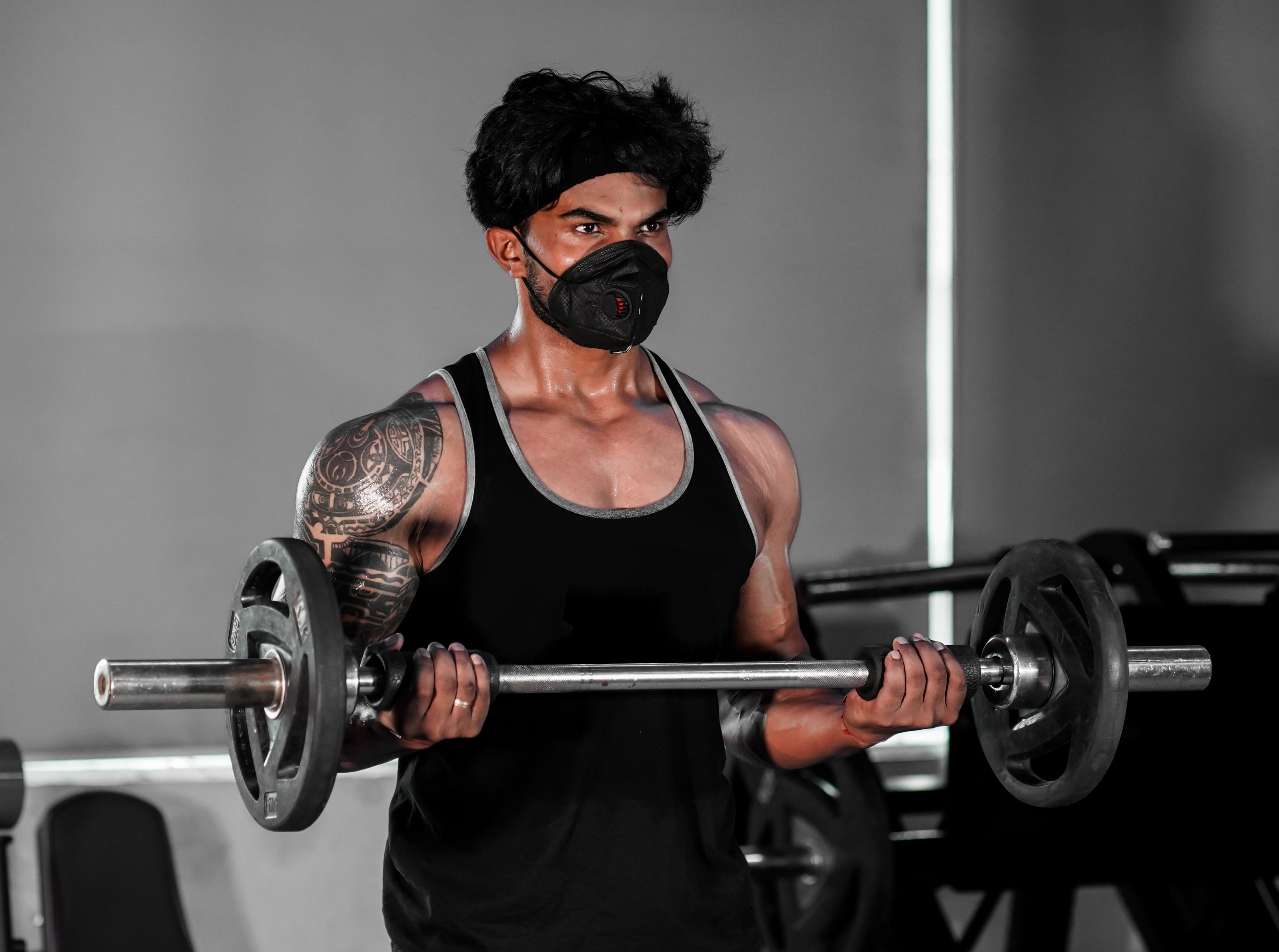 Fit Man Barbell Lifting in the Gym