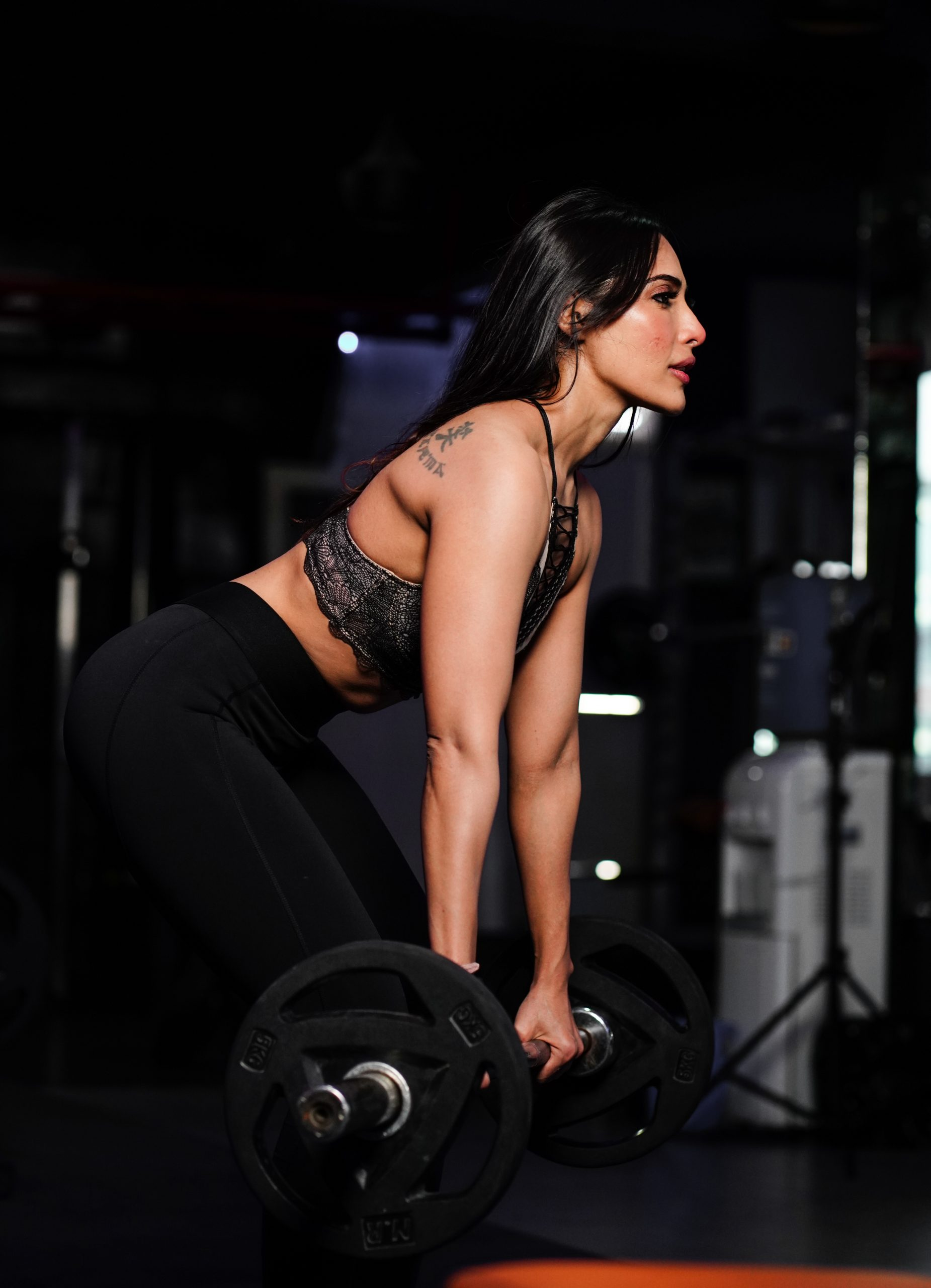Fit young woman lifting a barbell