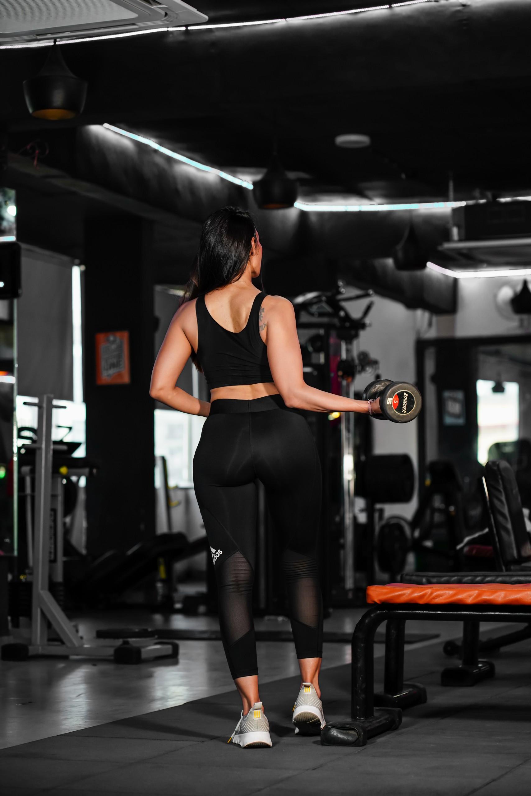 Fitness female model in gym