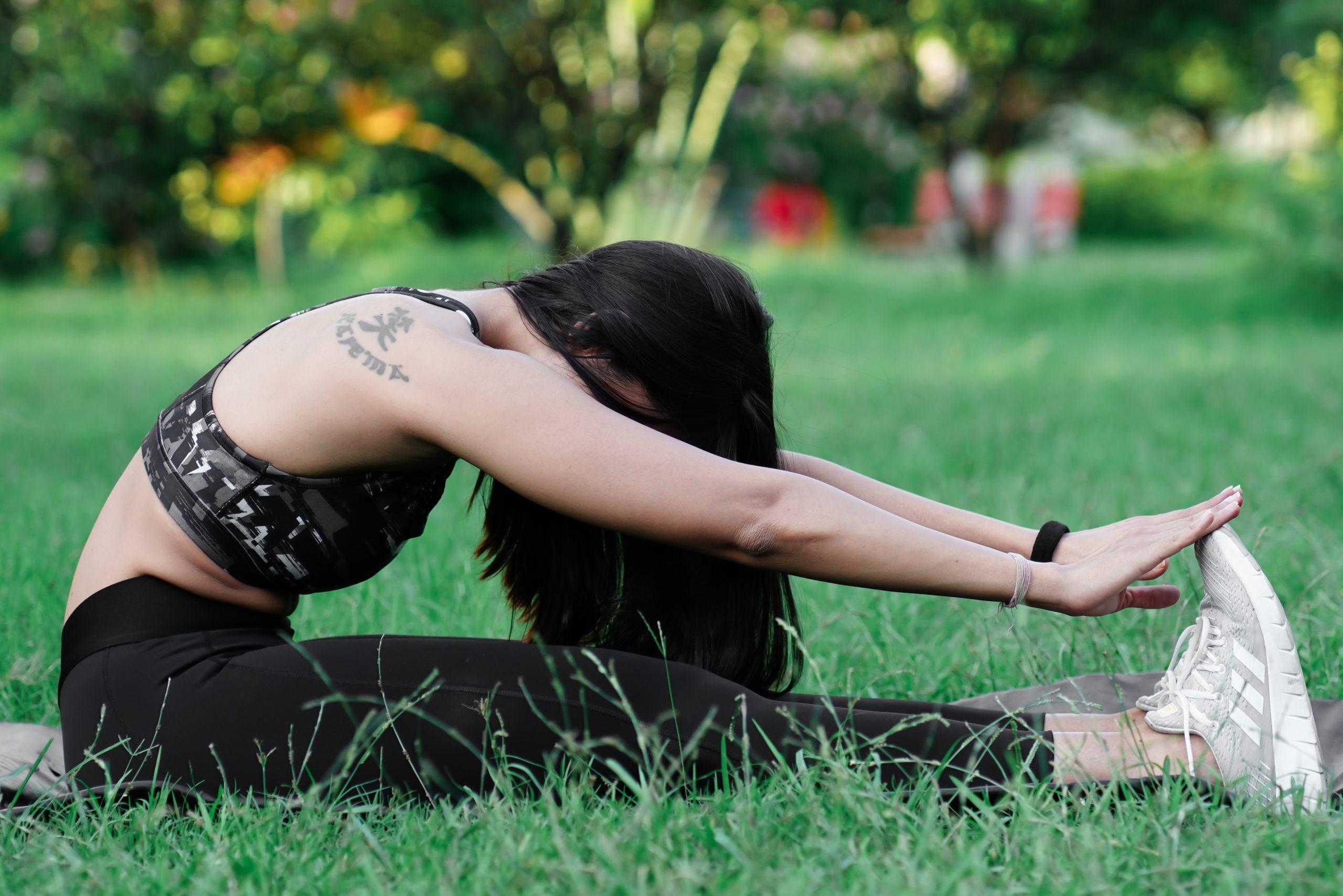 Fitness model do exercise in park area