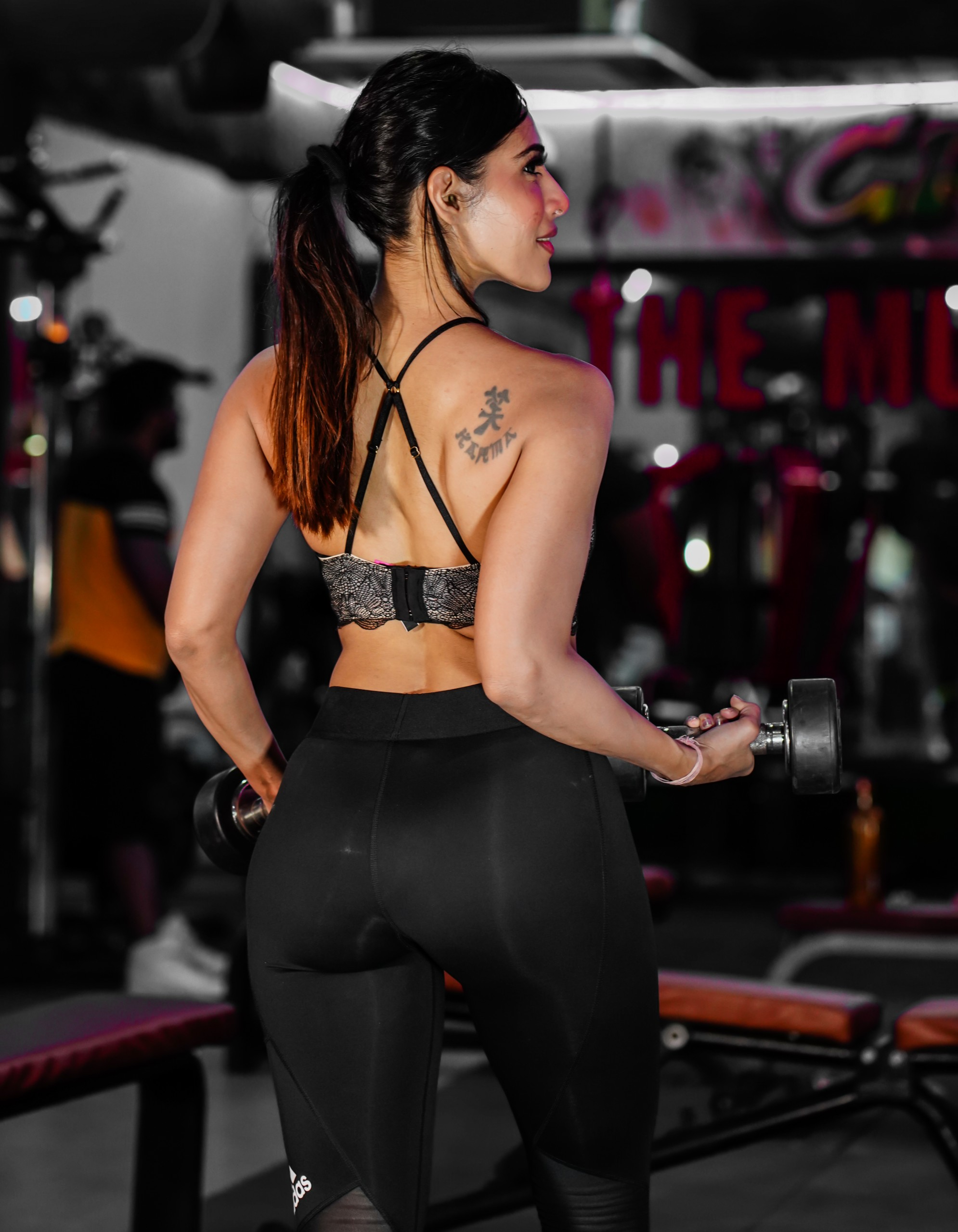 fitness model in gym with dumbbells