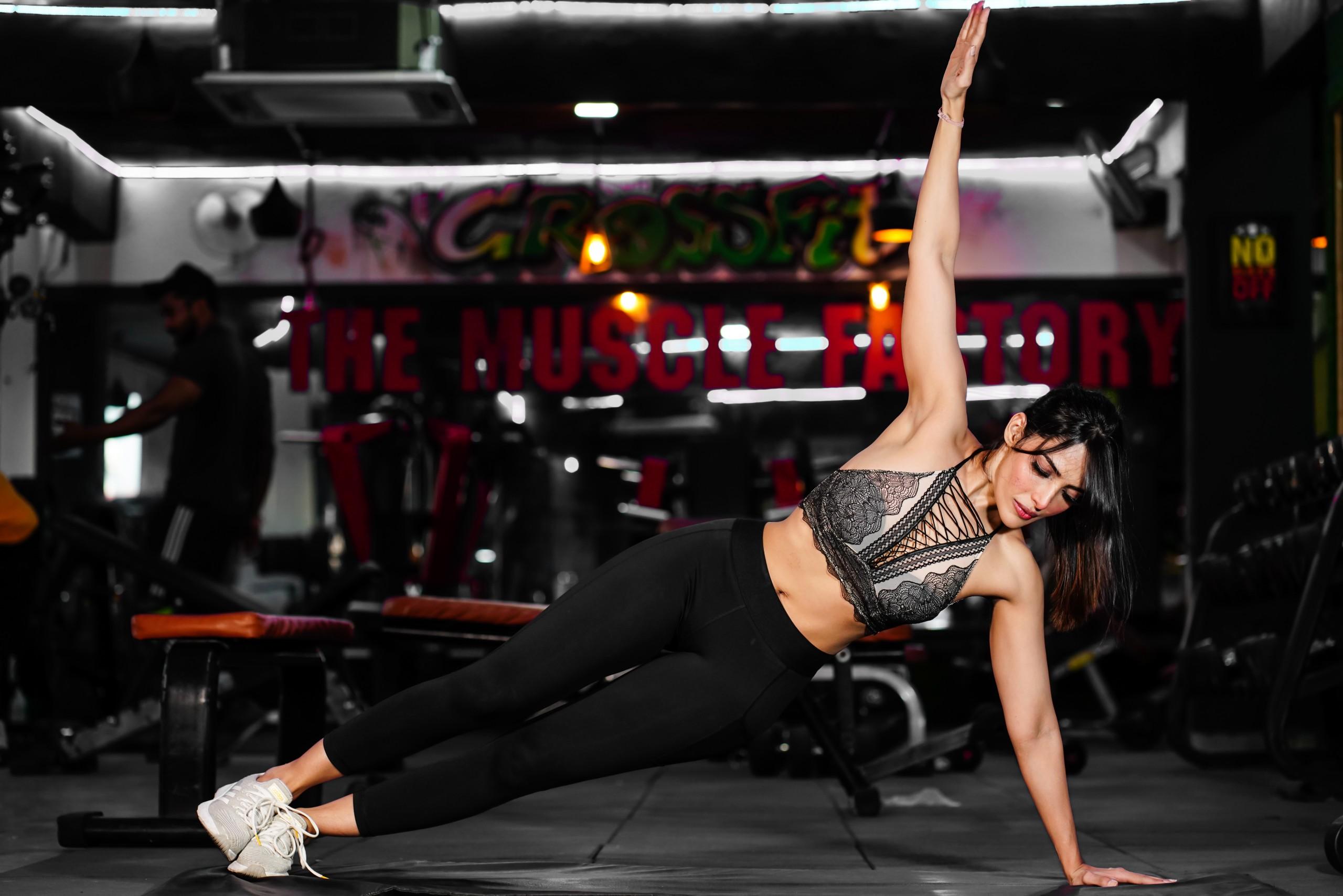 Girl doing yoga in gym