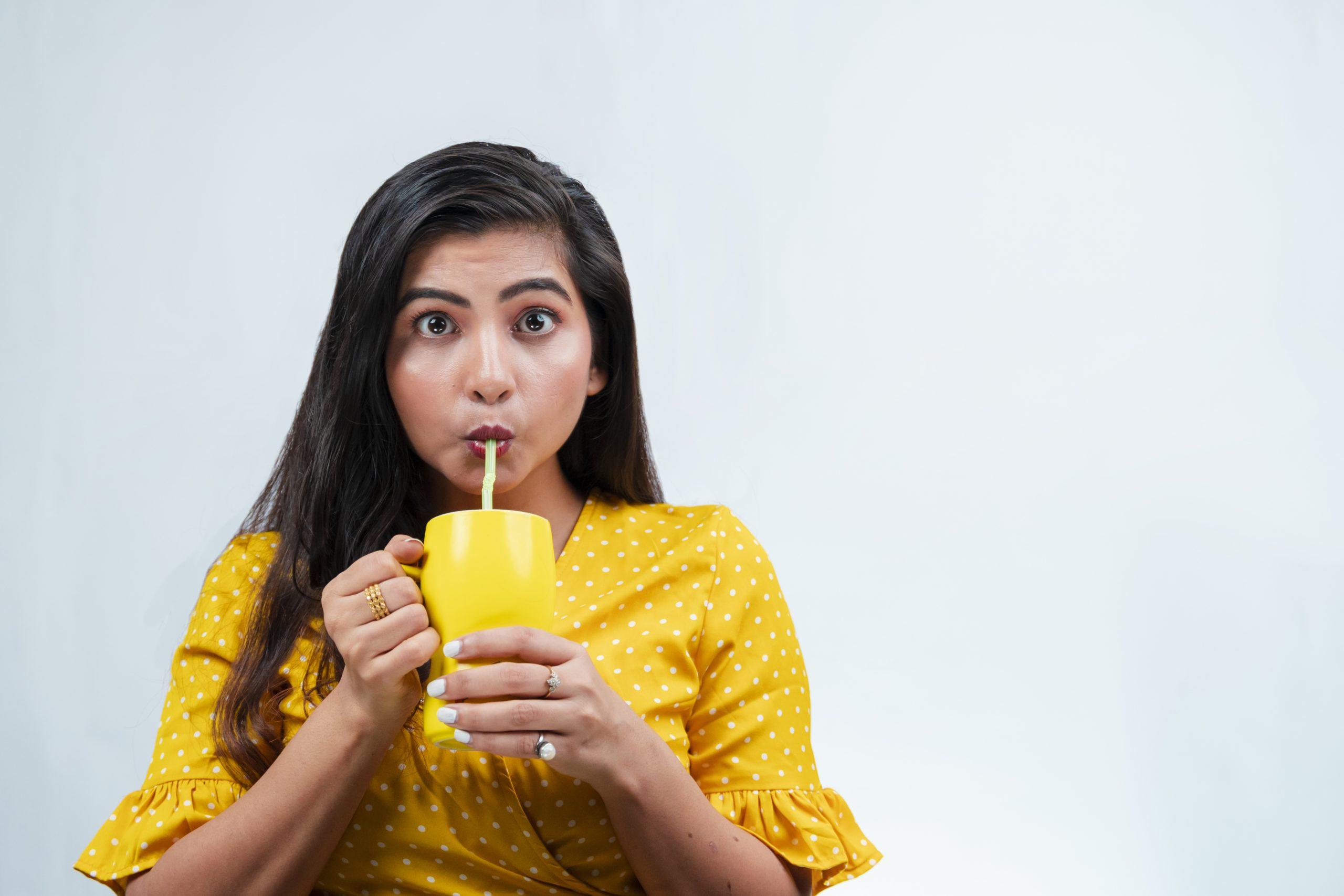 Girl drinking on White Background