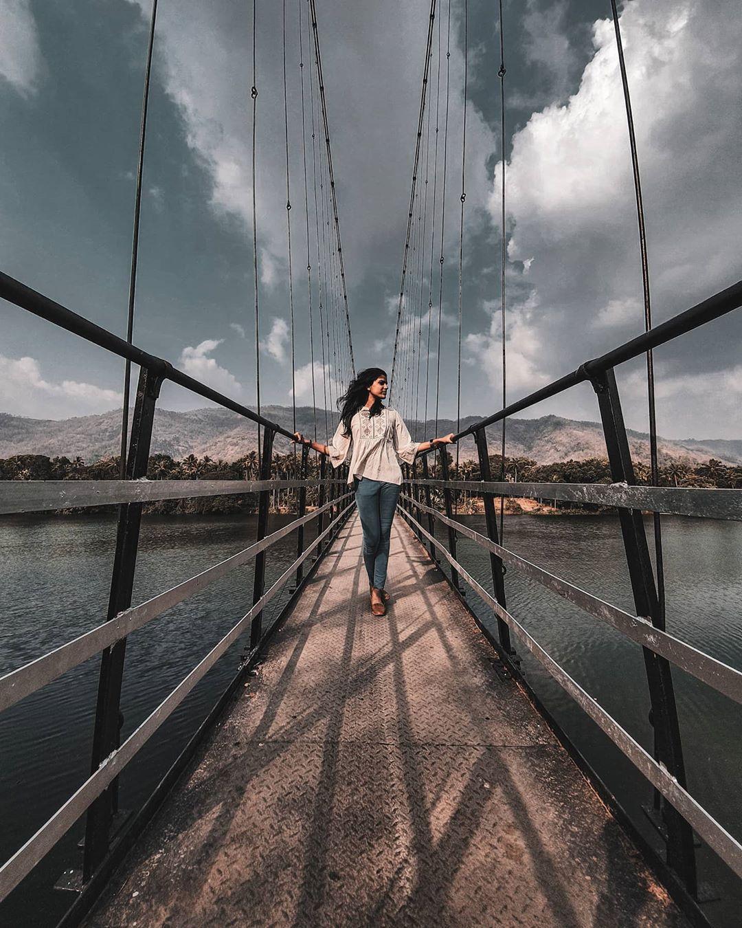 kerala girl on a bridge