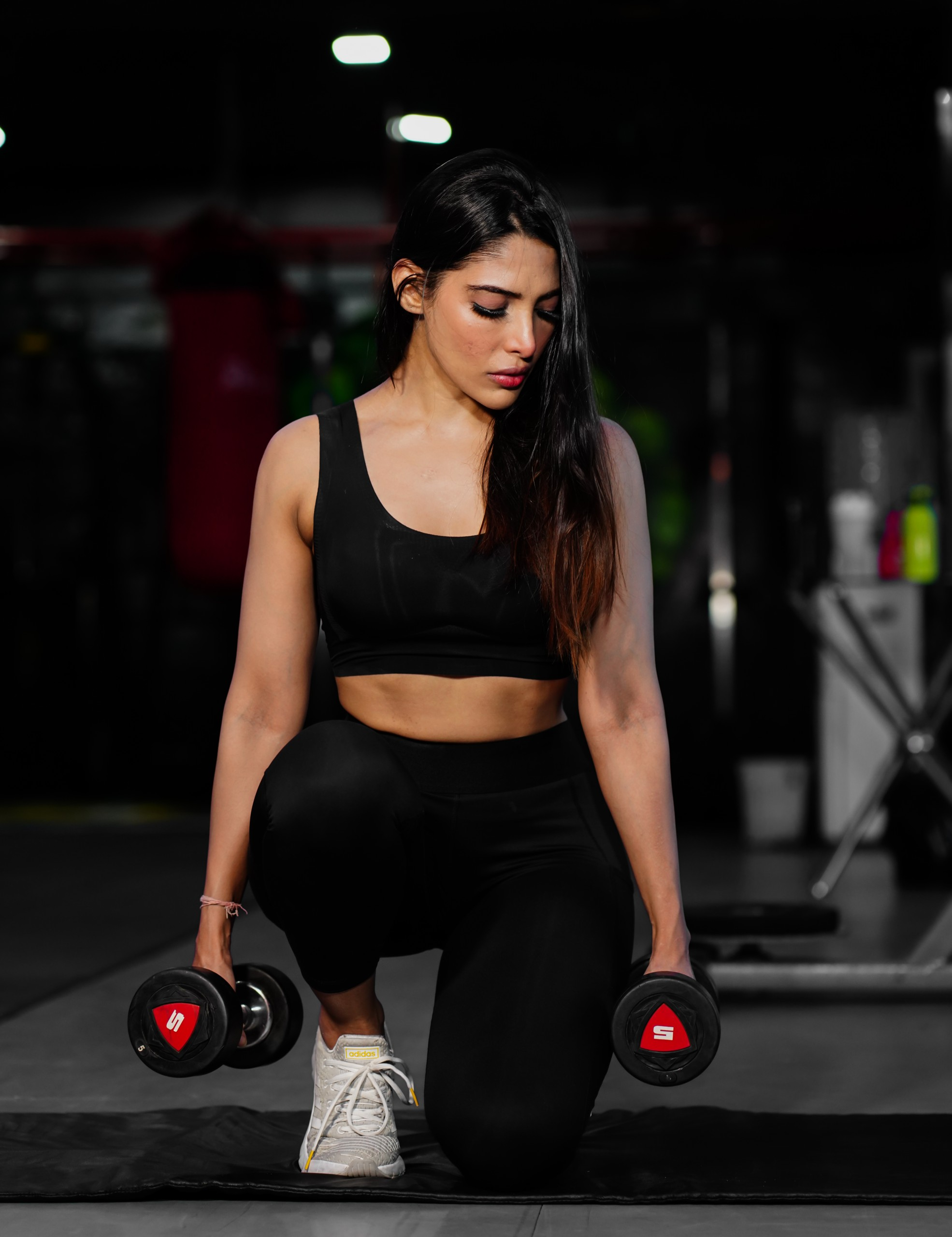 girl with dumbbells in gym