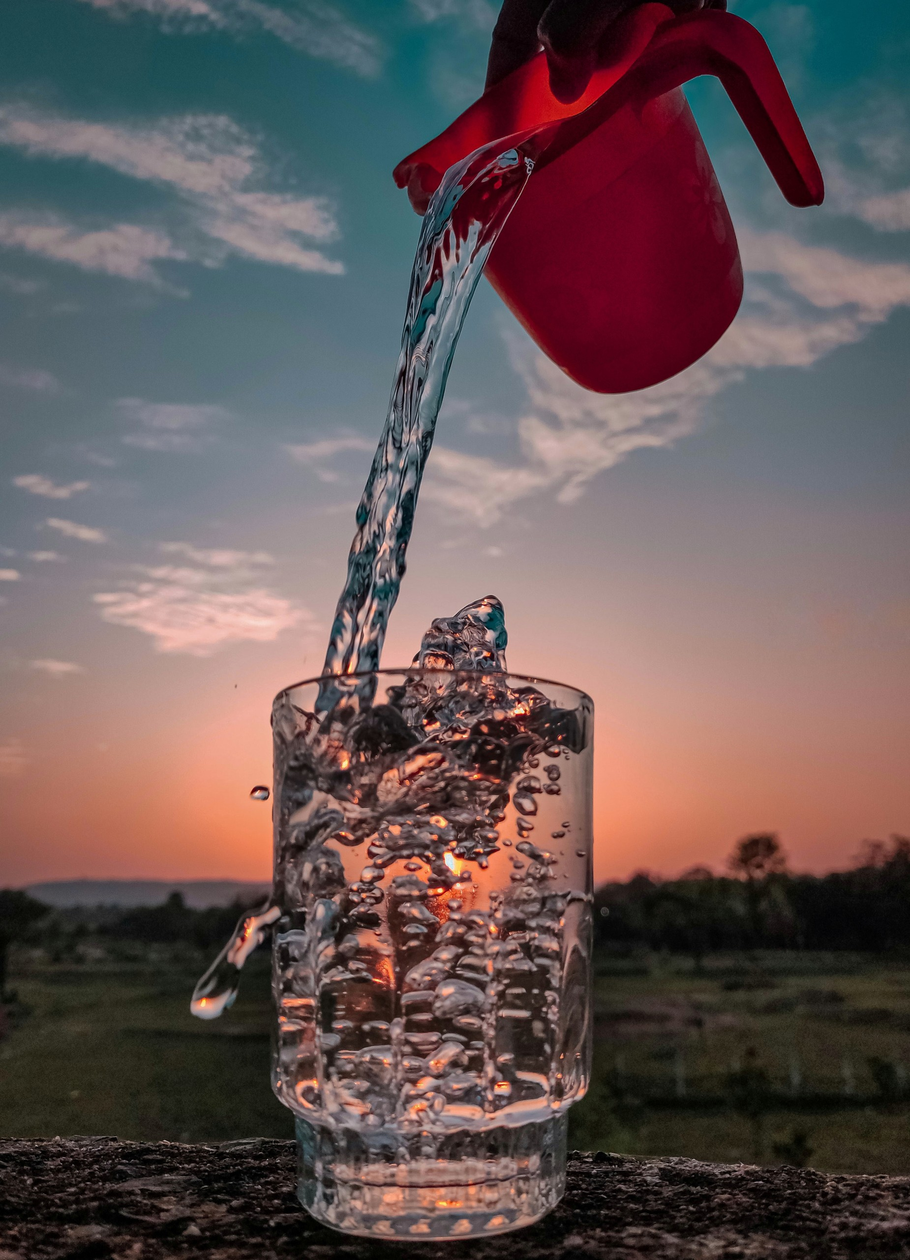 Glass of water and sunset