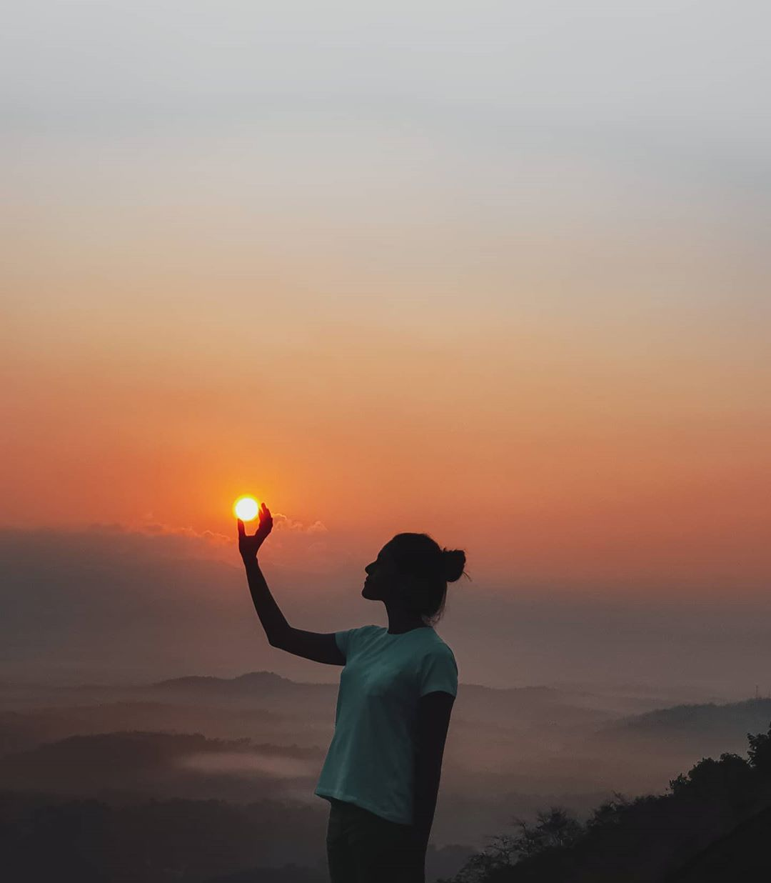Grabbing the Sun with Hand