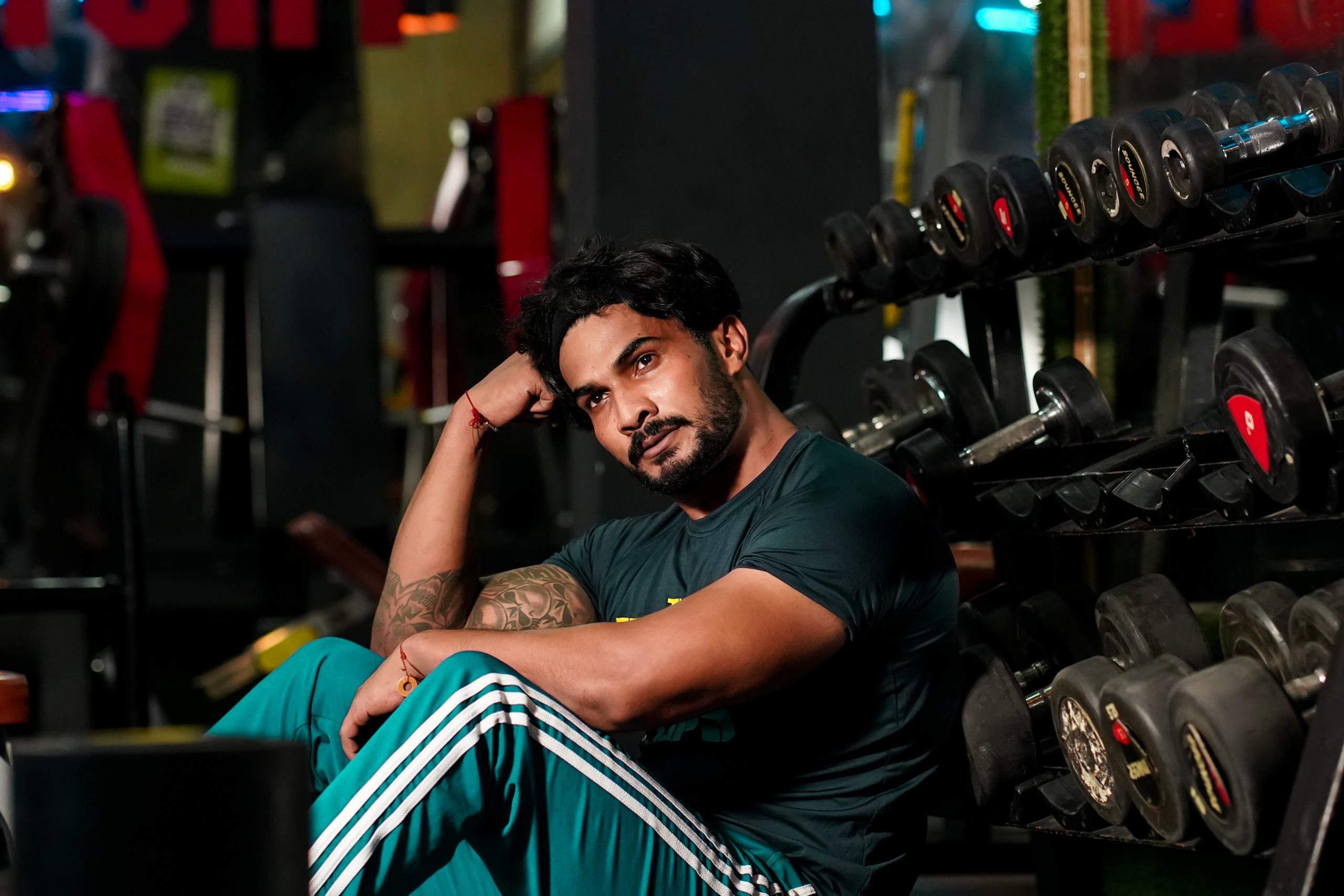 Gym boy sits on a floor