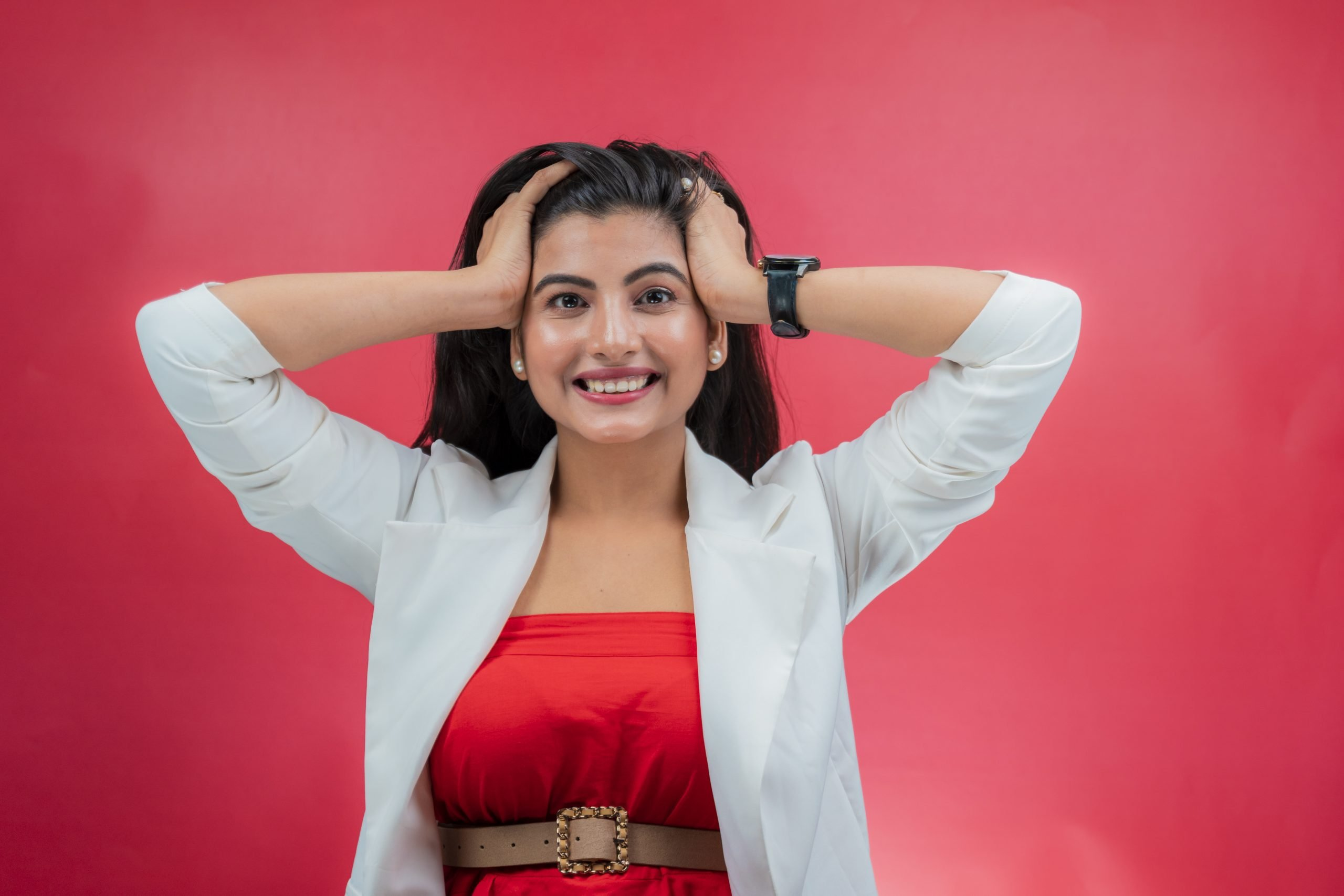 Happy Indian Girl on Red Background