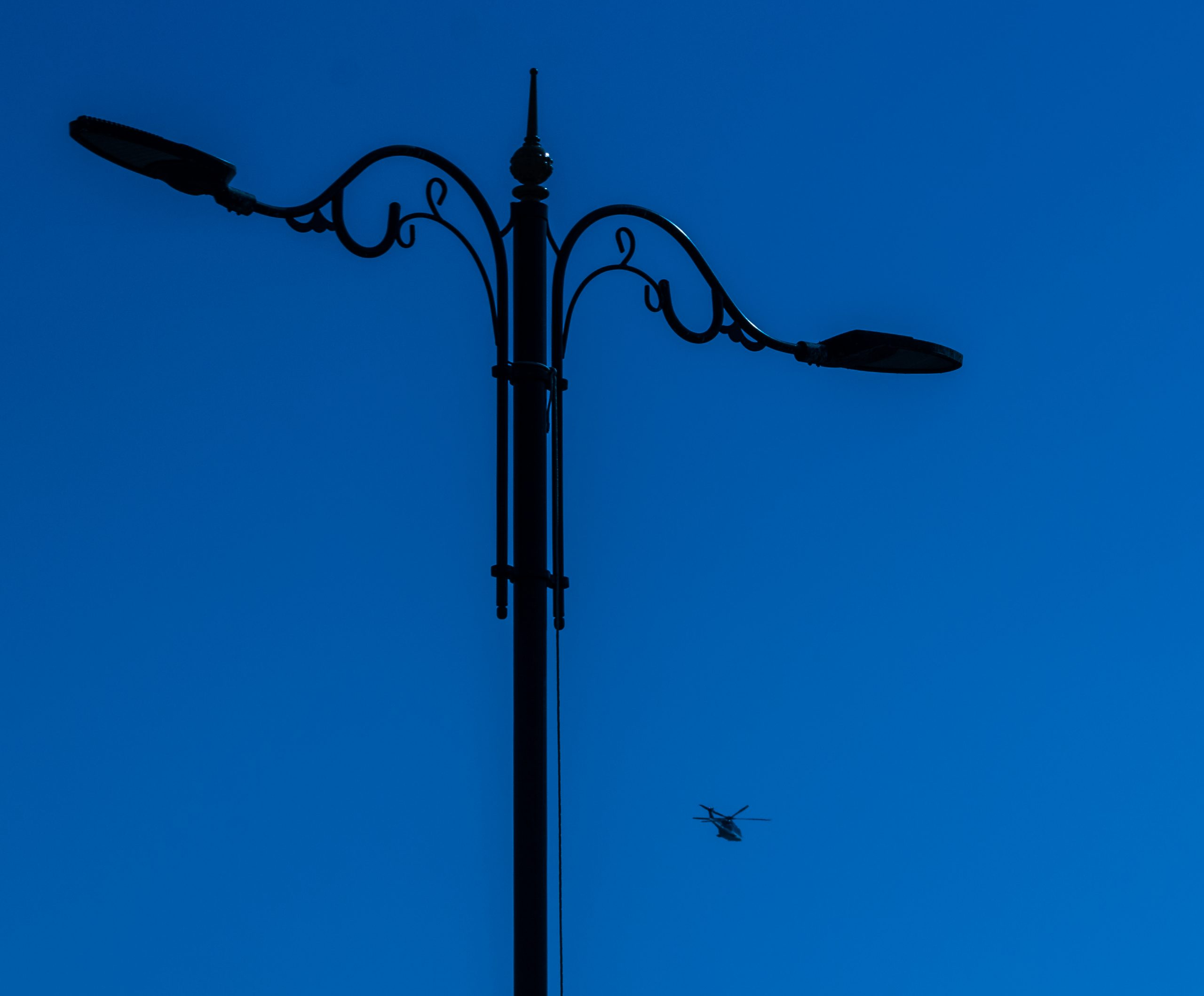 Helicopter visible behind the street lamp