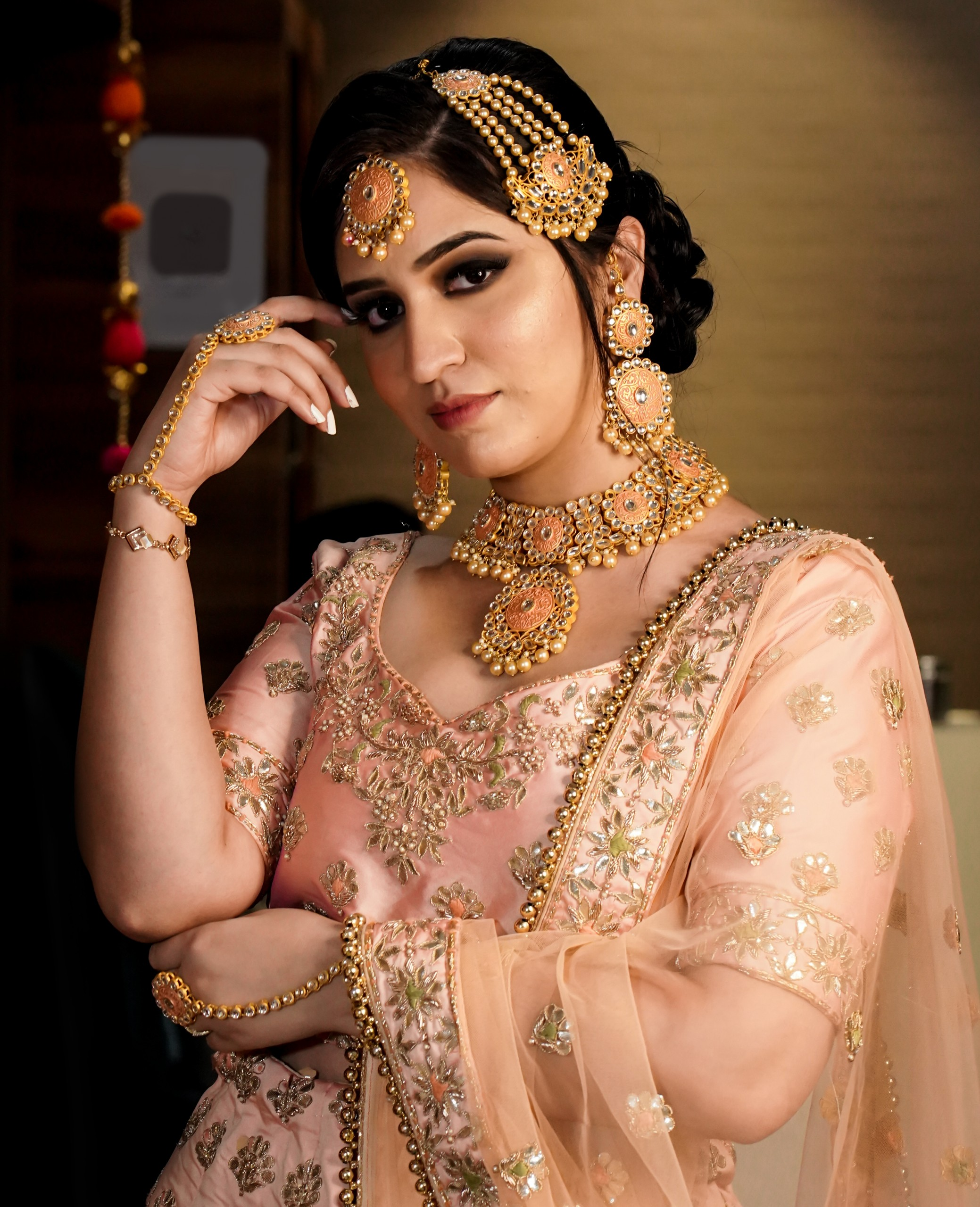 Indian bride with heavy jewelry