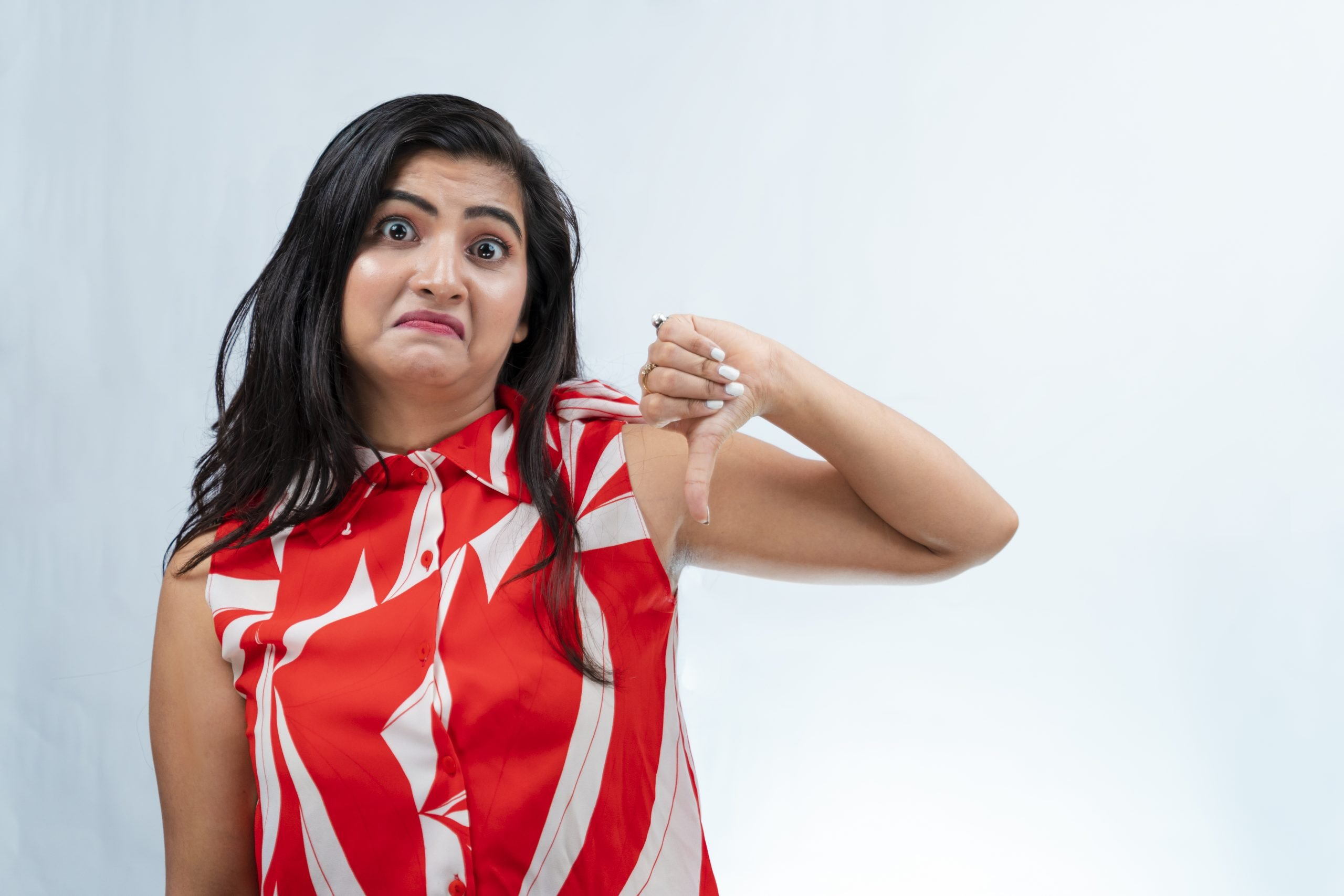Indian girl doing thumbs down