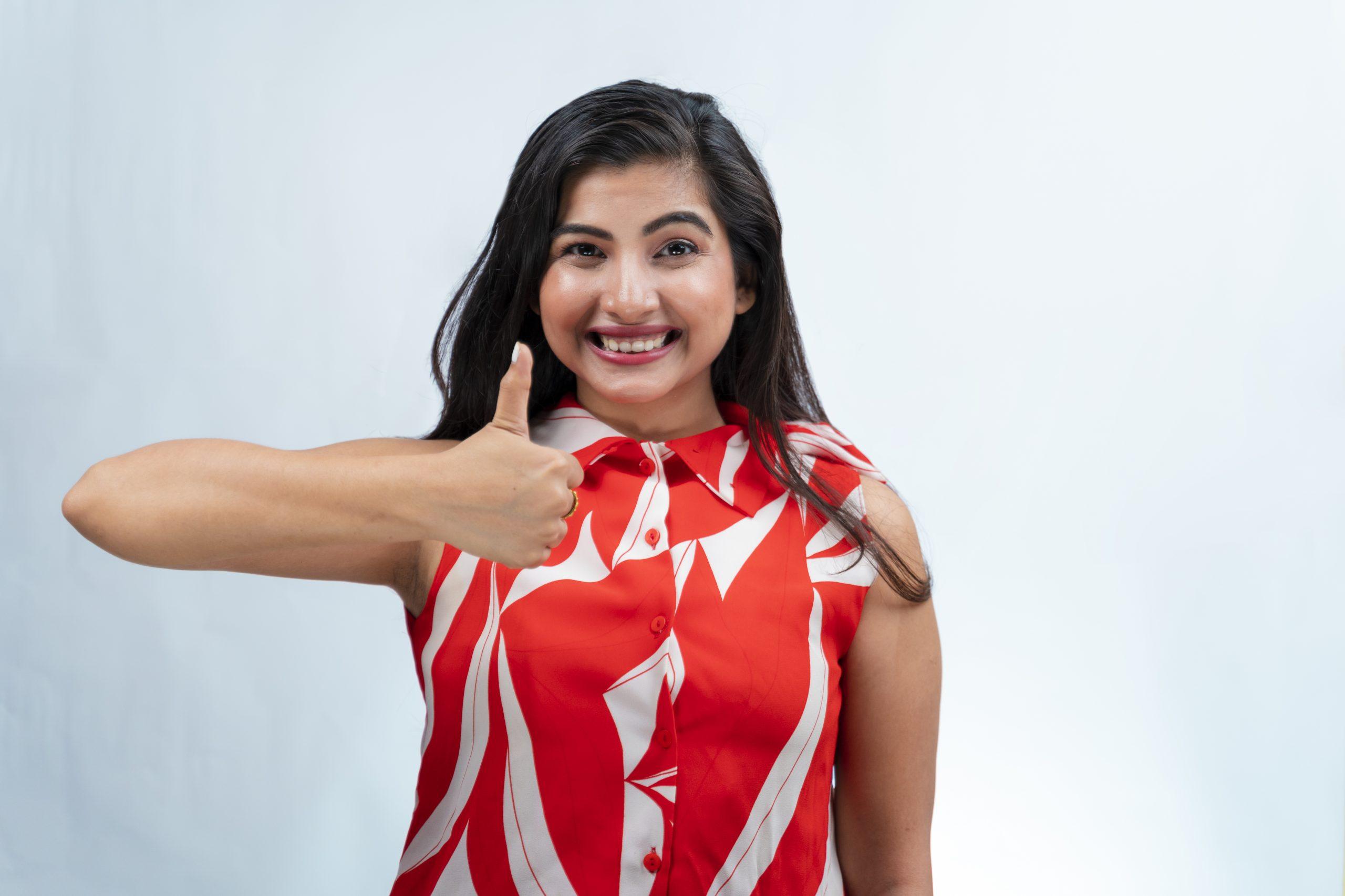 Indian girl doing thumbs up