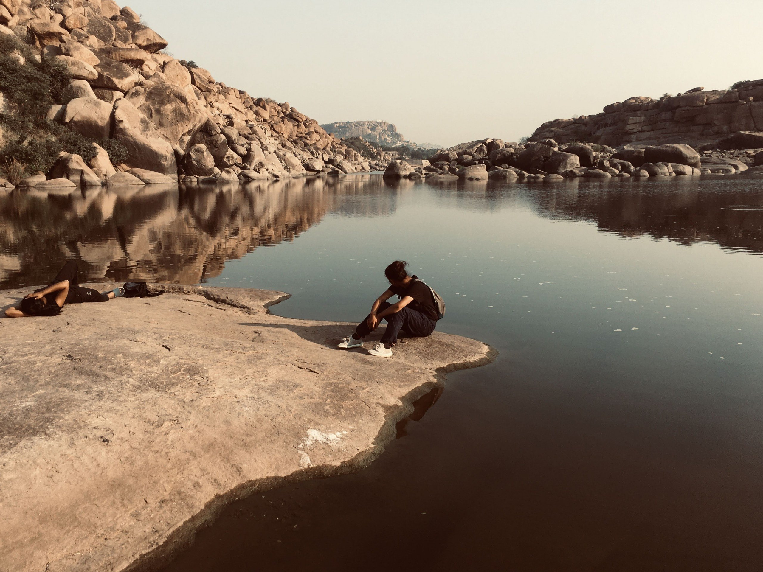 Man sitting by the water in Karnataka