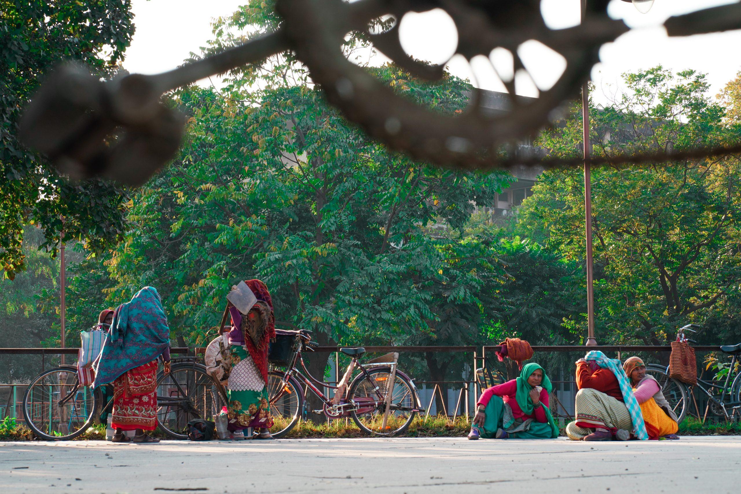 Ladies workers beside a road