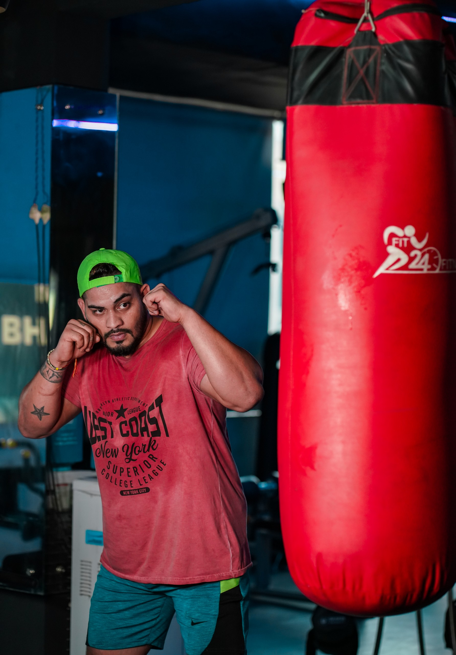 man punching the punching bag