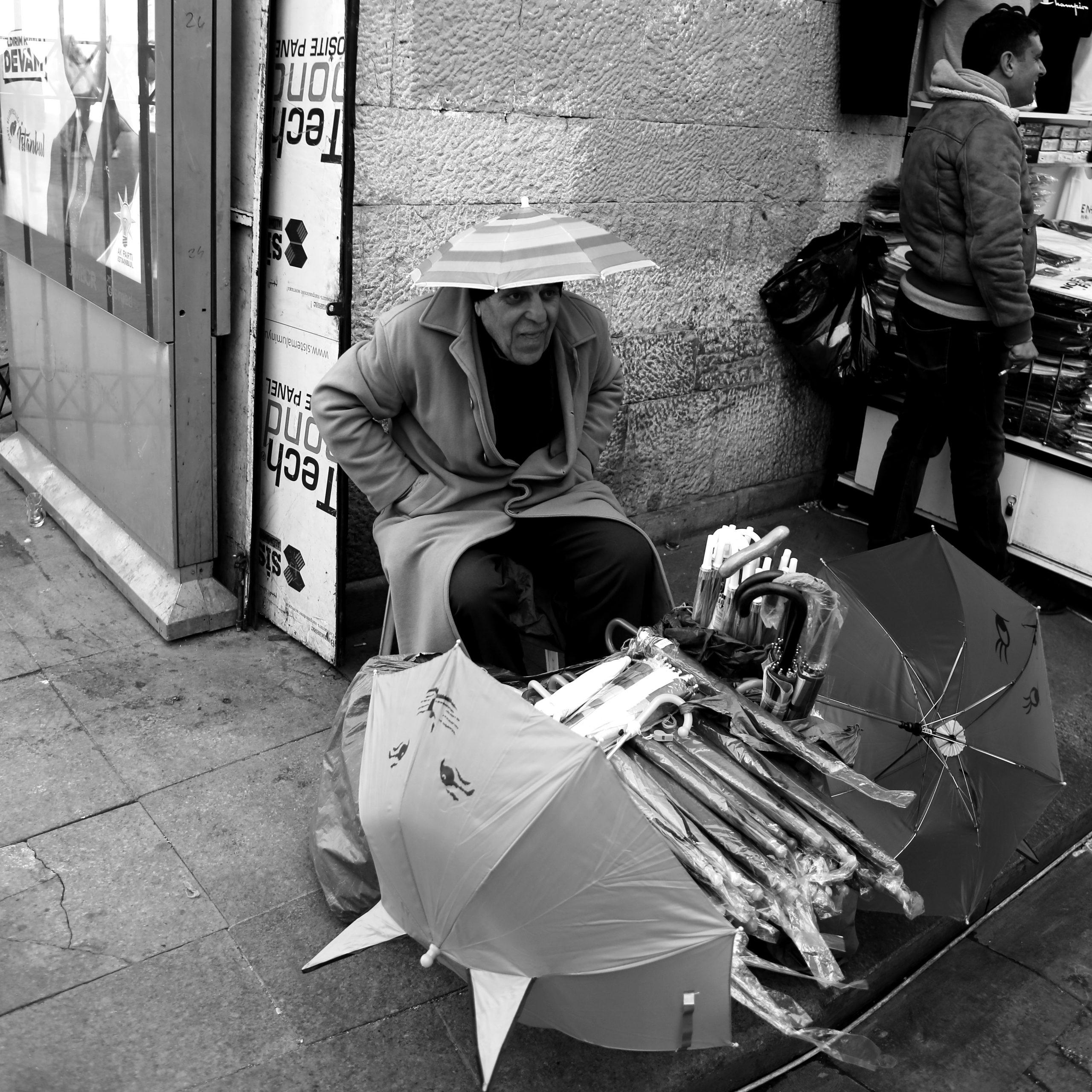 Man selling umbrella in the street