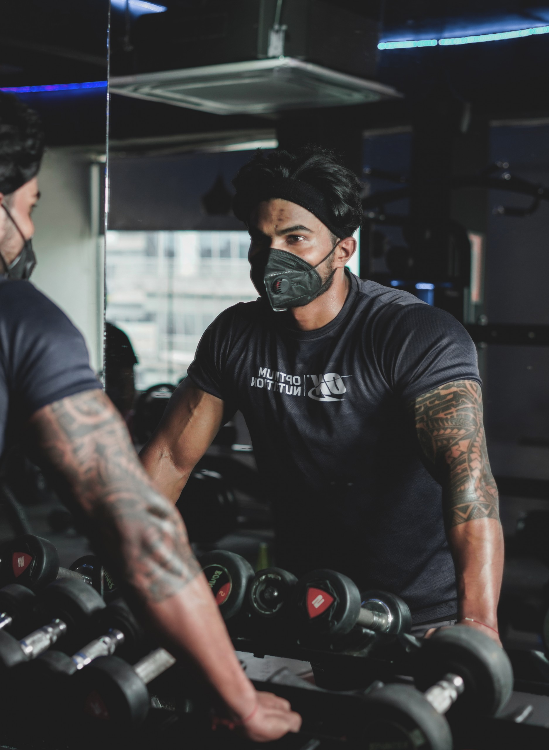 Man wearing mask in a gym