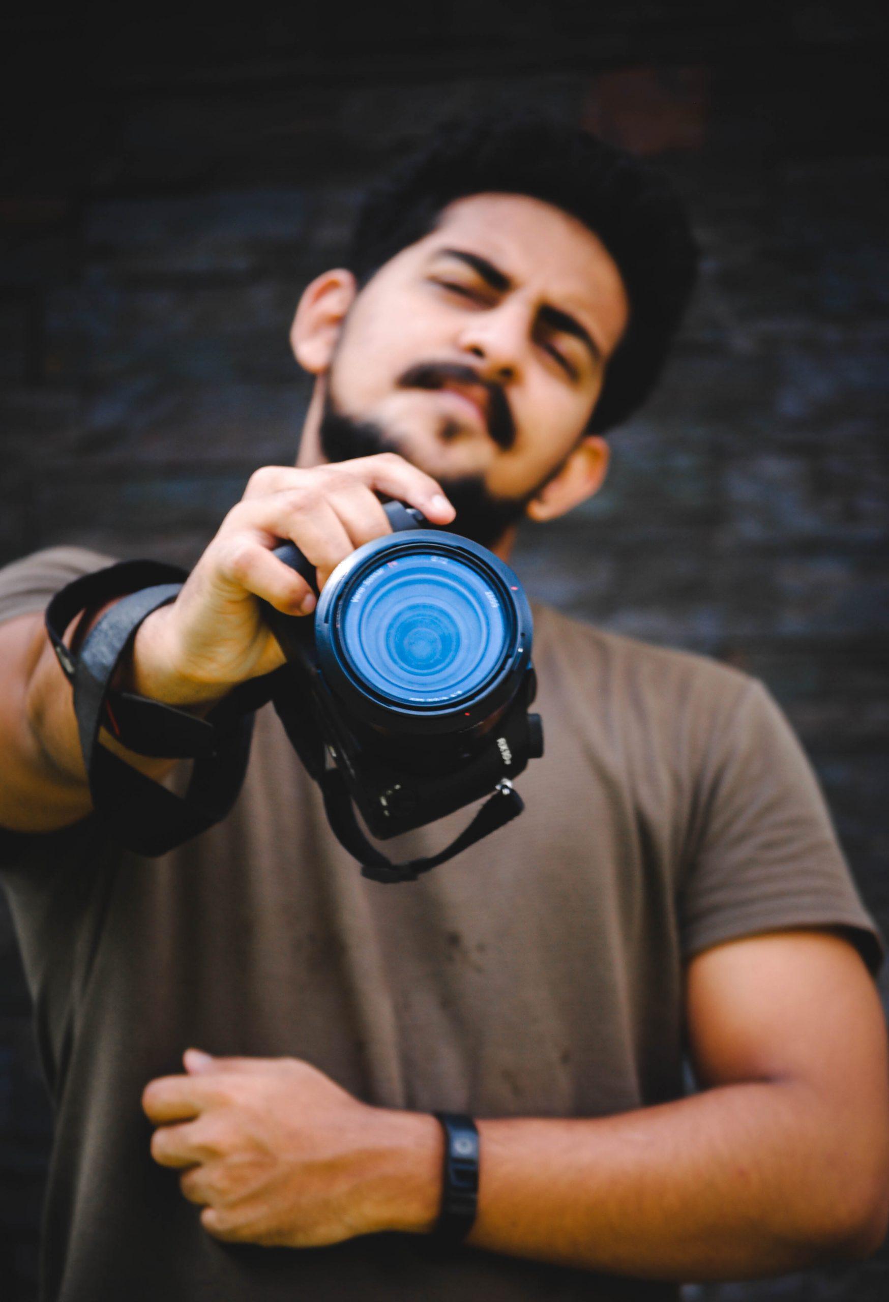 Photographer with Sony RX10 iii