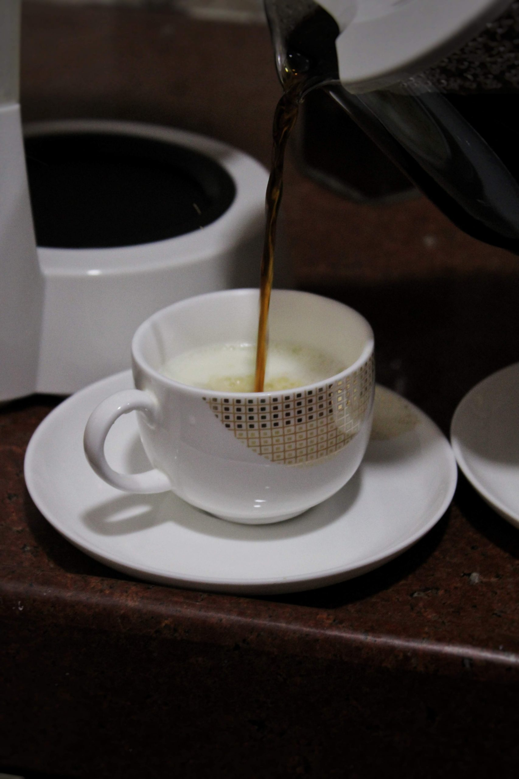 Pouring Coffee to a Cup